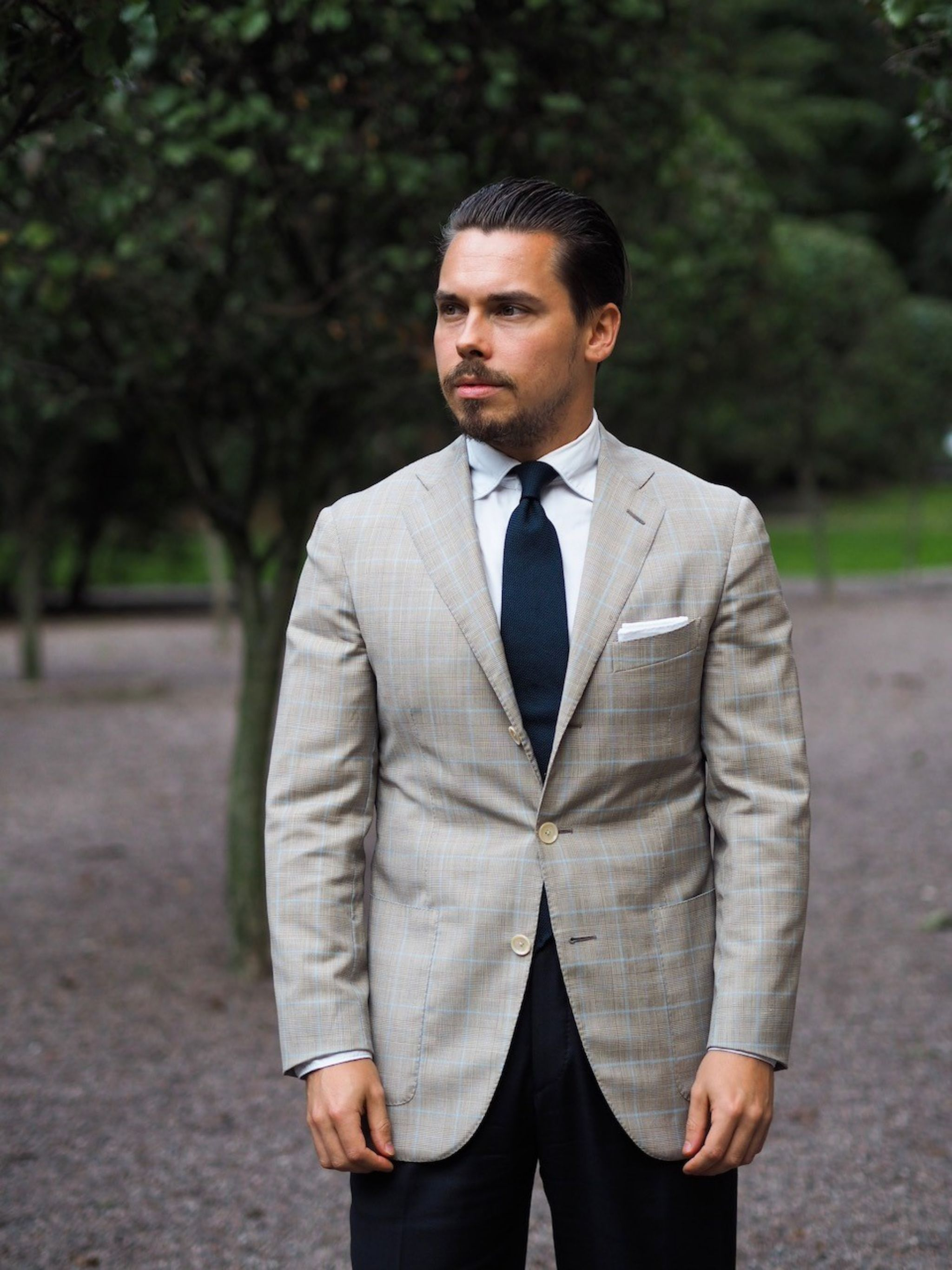 Caruso checked sport coat with blue suit trousers - a perfect look for business occasions