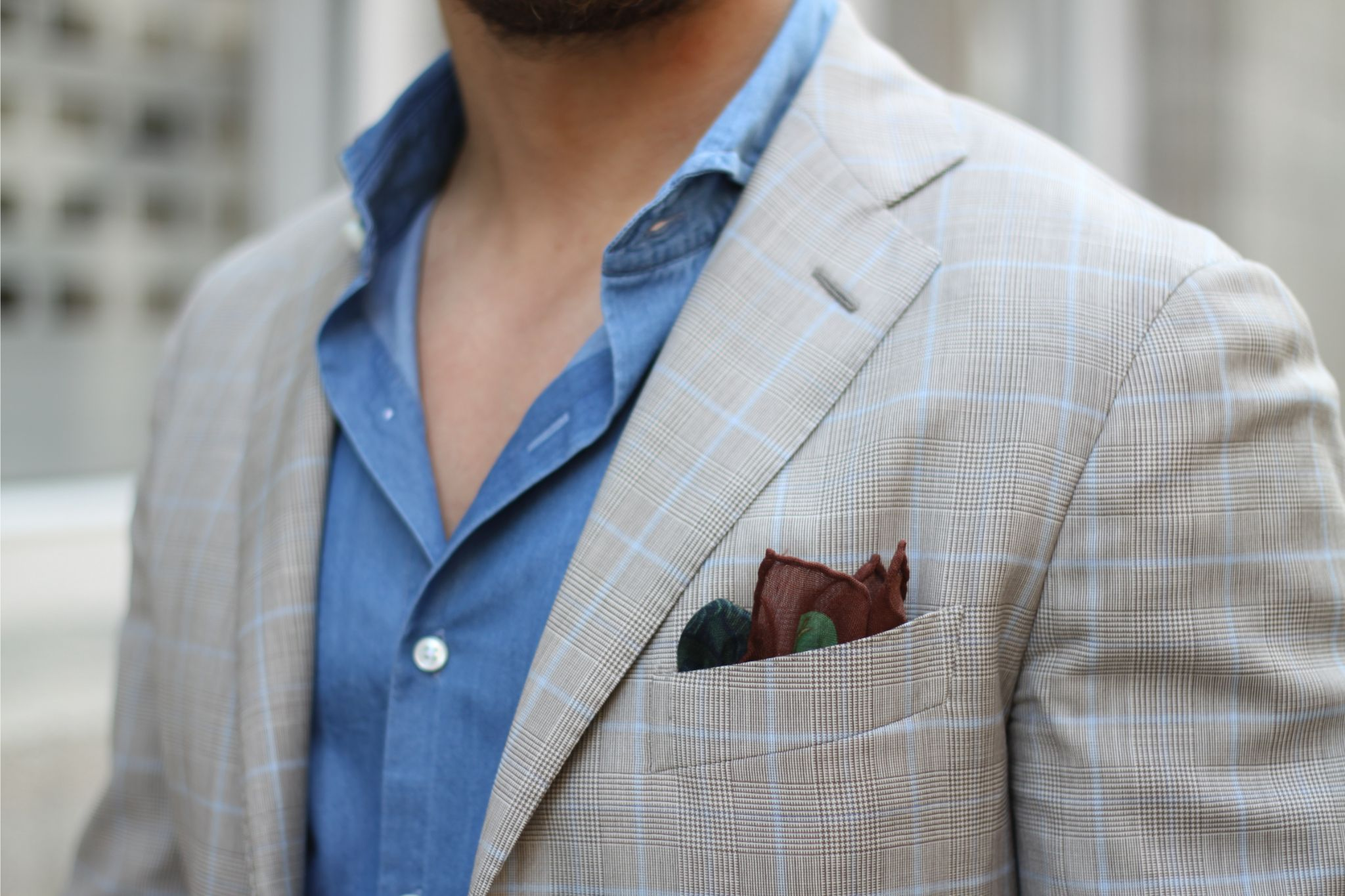 Checked sport coat with denim shirt and wool silk pocket square
