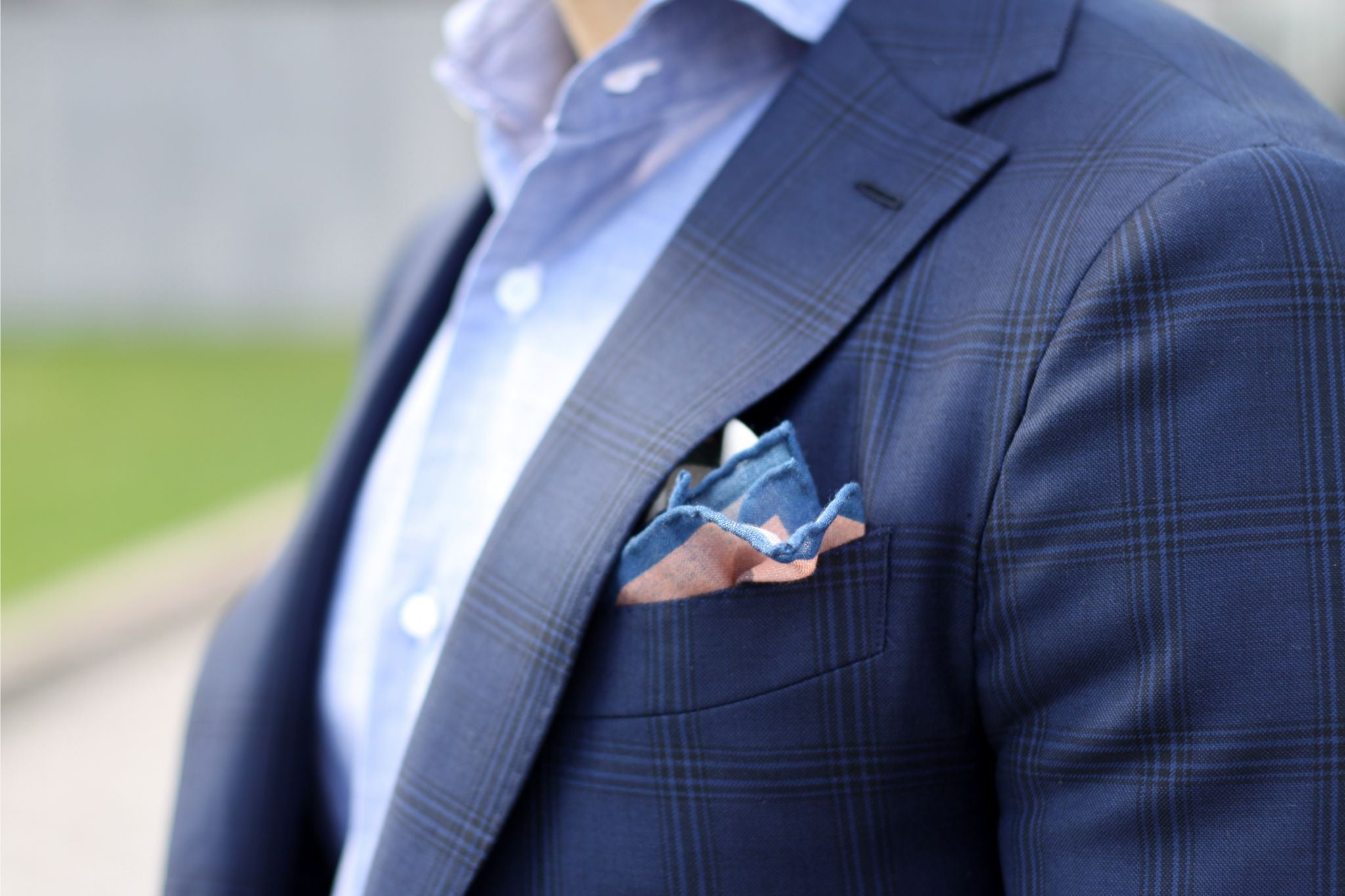 Christian Kimber pocket square with Isaia shirt and blue suit jacket