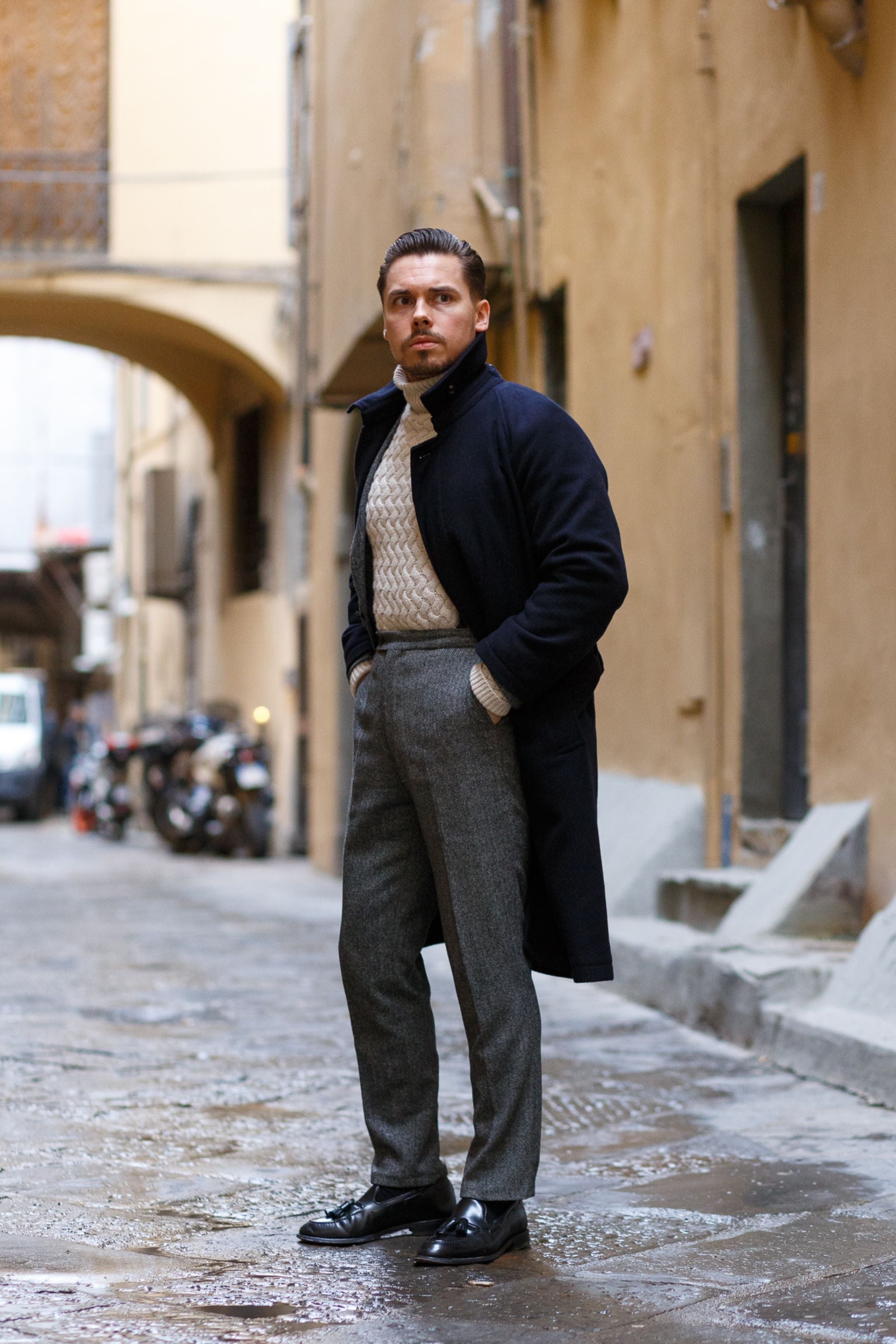 Chunky-roll-neck-sweater-with-a-suit-and-blue-wool-overcoat