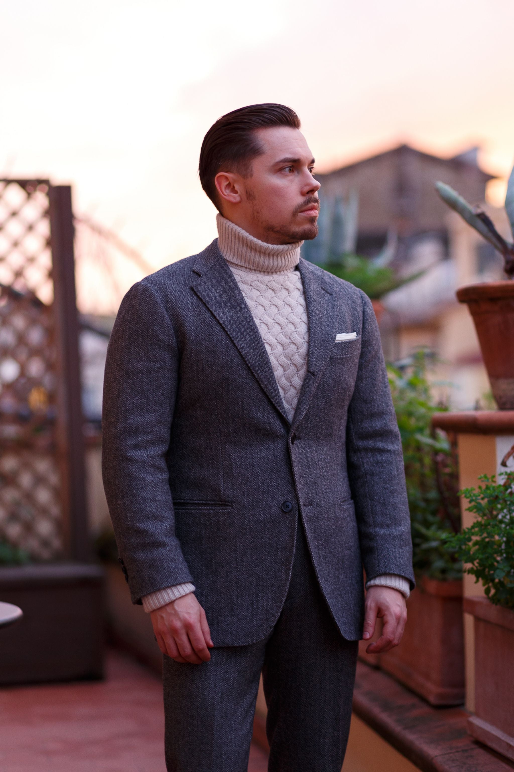 Chunky-oatmeal-colored-roll-neck-sweater-with-a-herringbone-wool-suit