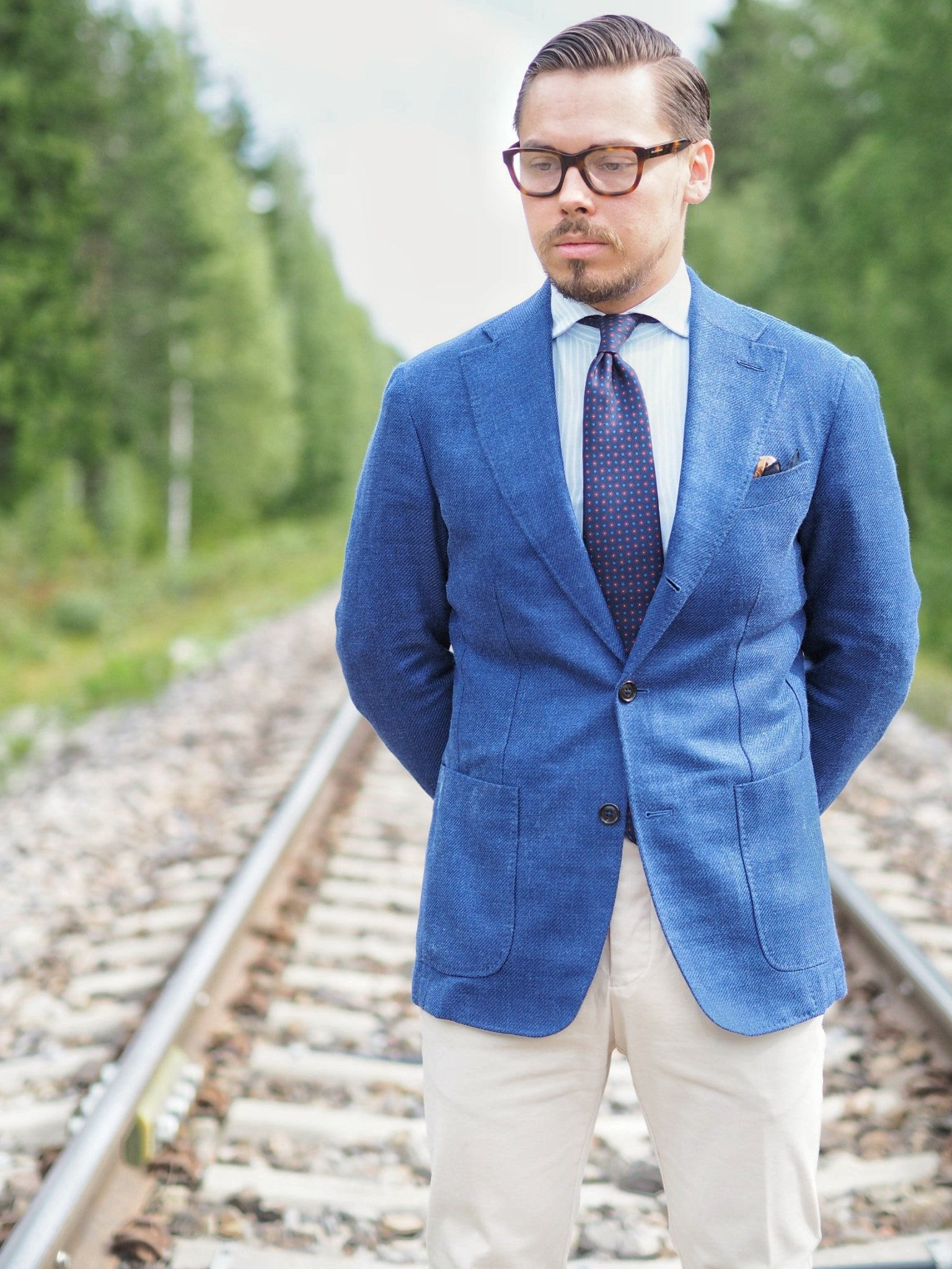 Blue suit jacket as a sport coat - light colored cotton slacks with the mid-blue jacket and printed silk tie