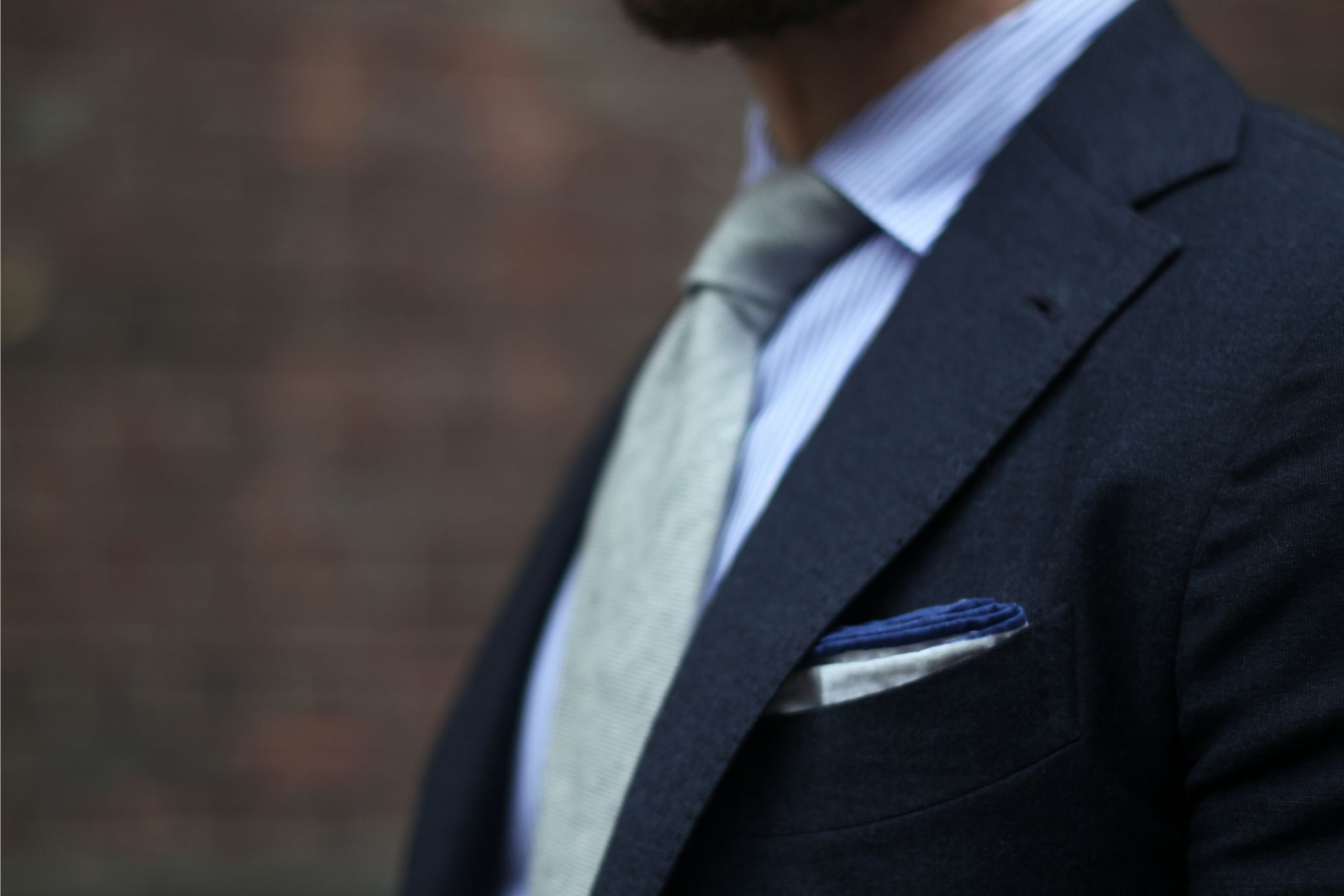Gray suit with gray tie - white cotton pocket square with blue borders