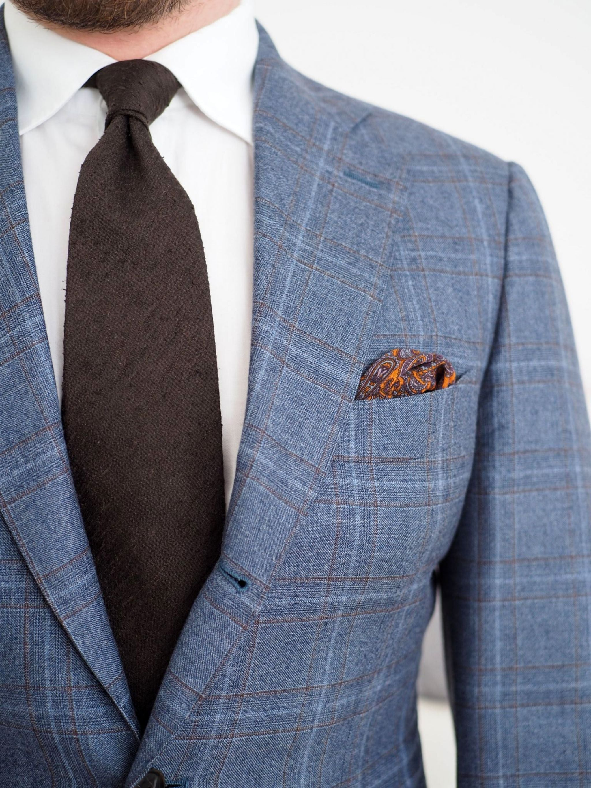 Gray suit with restrained check pattern and soft textures.