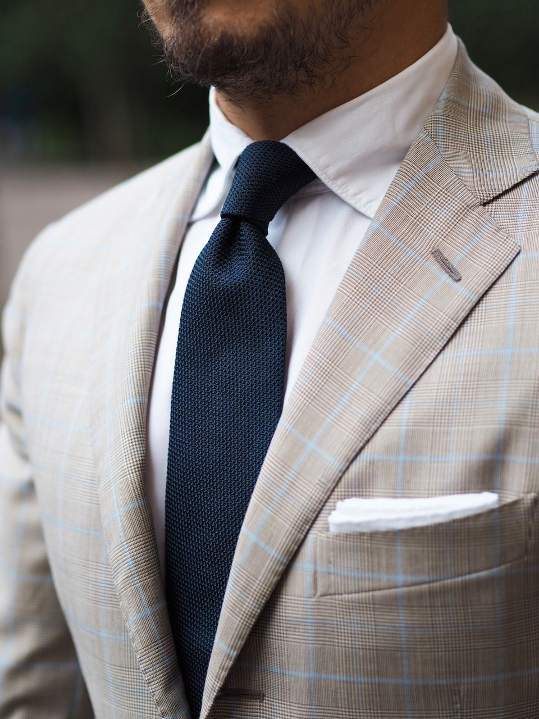 DLA navy blue grenadine tie texture with checked sport coat white shirt and white linen pocket square