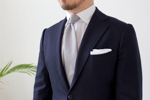 What to wear for wedding party - Blue suit, white shirt and silver grenadine tie with white linen pocket square is the ultimate wedding outfit.