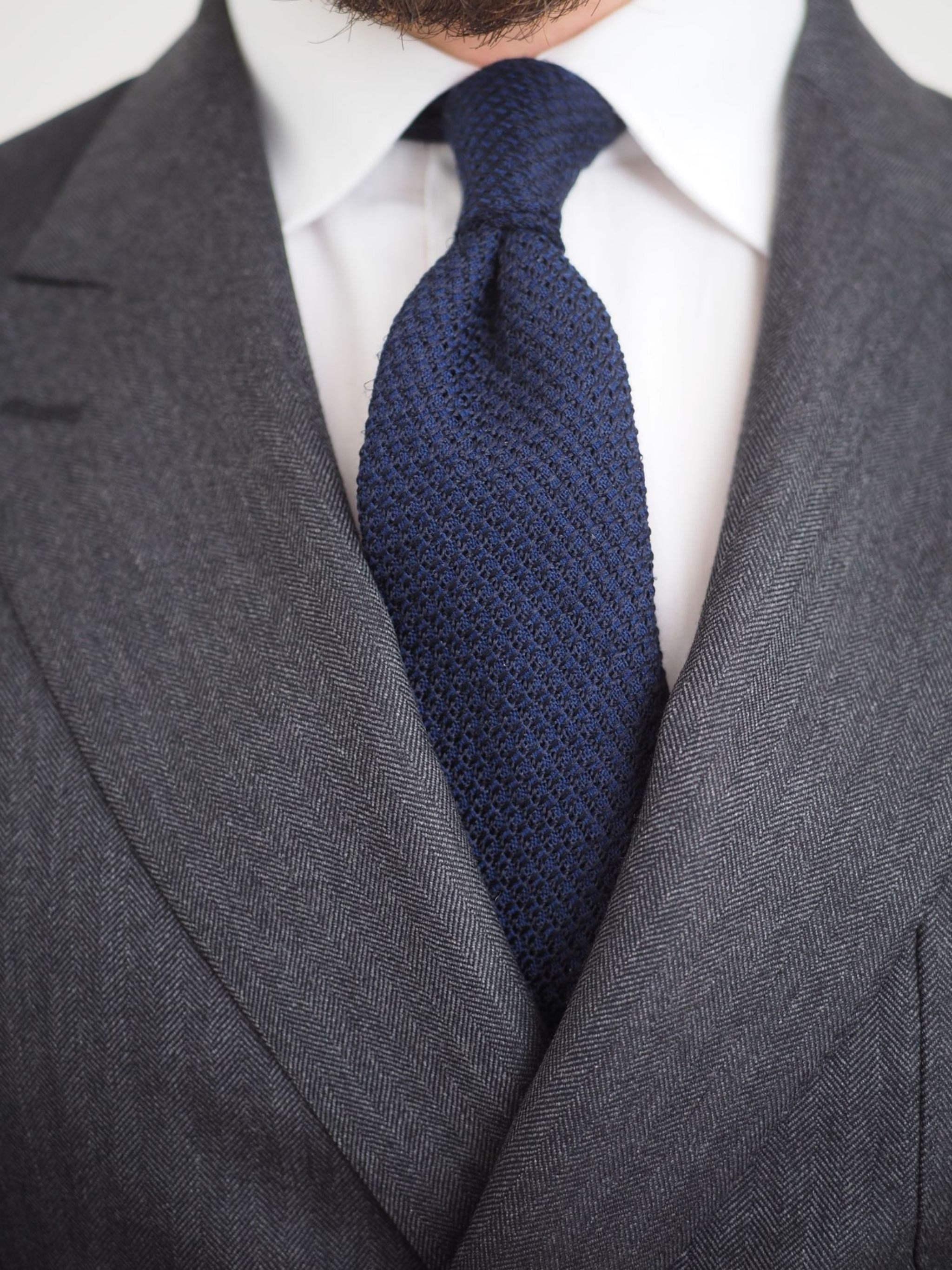 Blue grenadine silk-wool tie with double four-in-hand knot