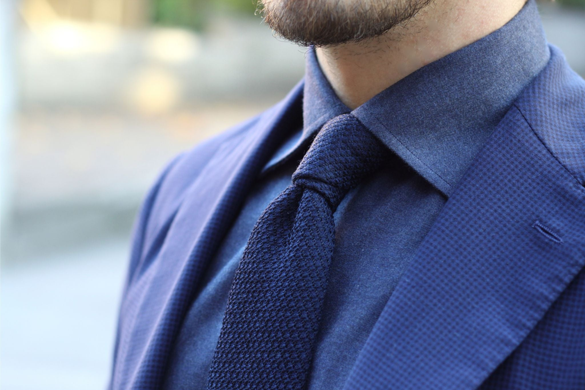What color tie goes with a dark blue shirt