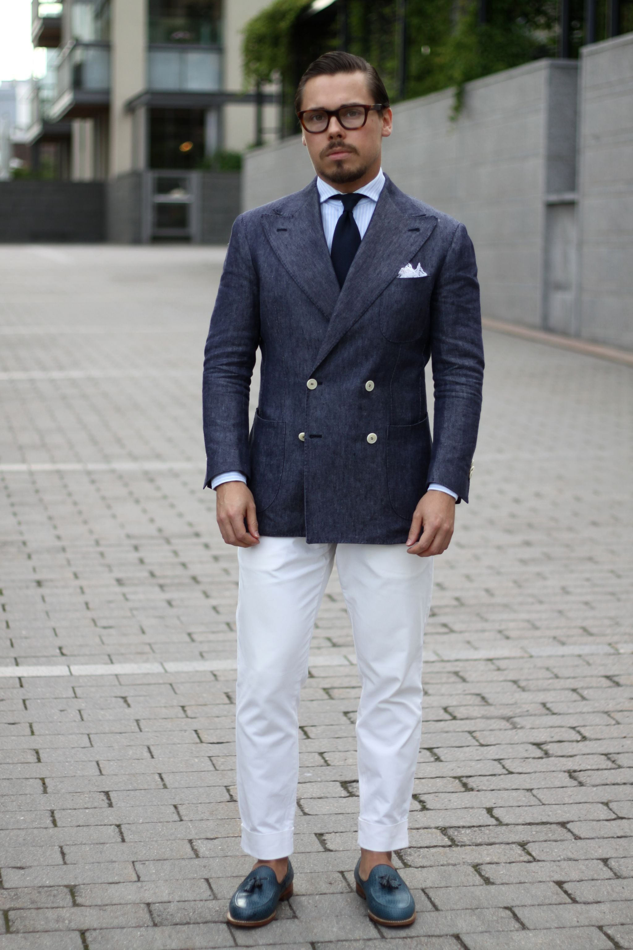 Double-breasted linen jacket with white cotton slacks