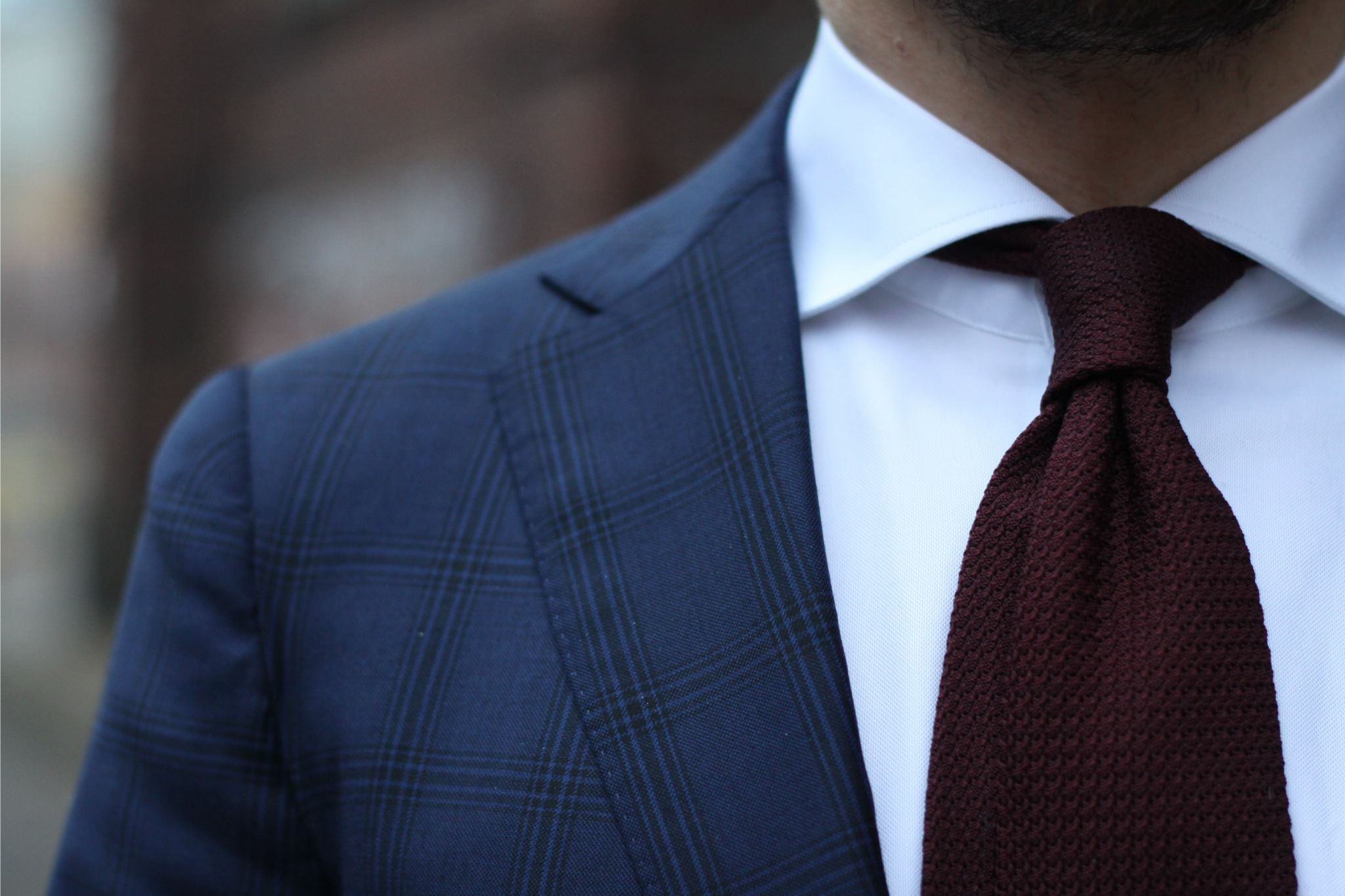 Burgundy grenadine tie with double four-in-hand knot