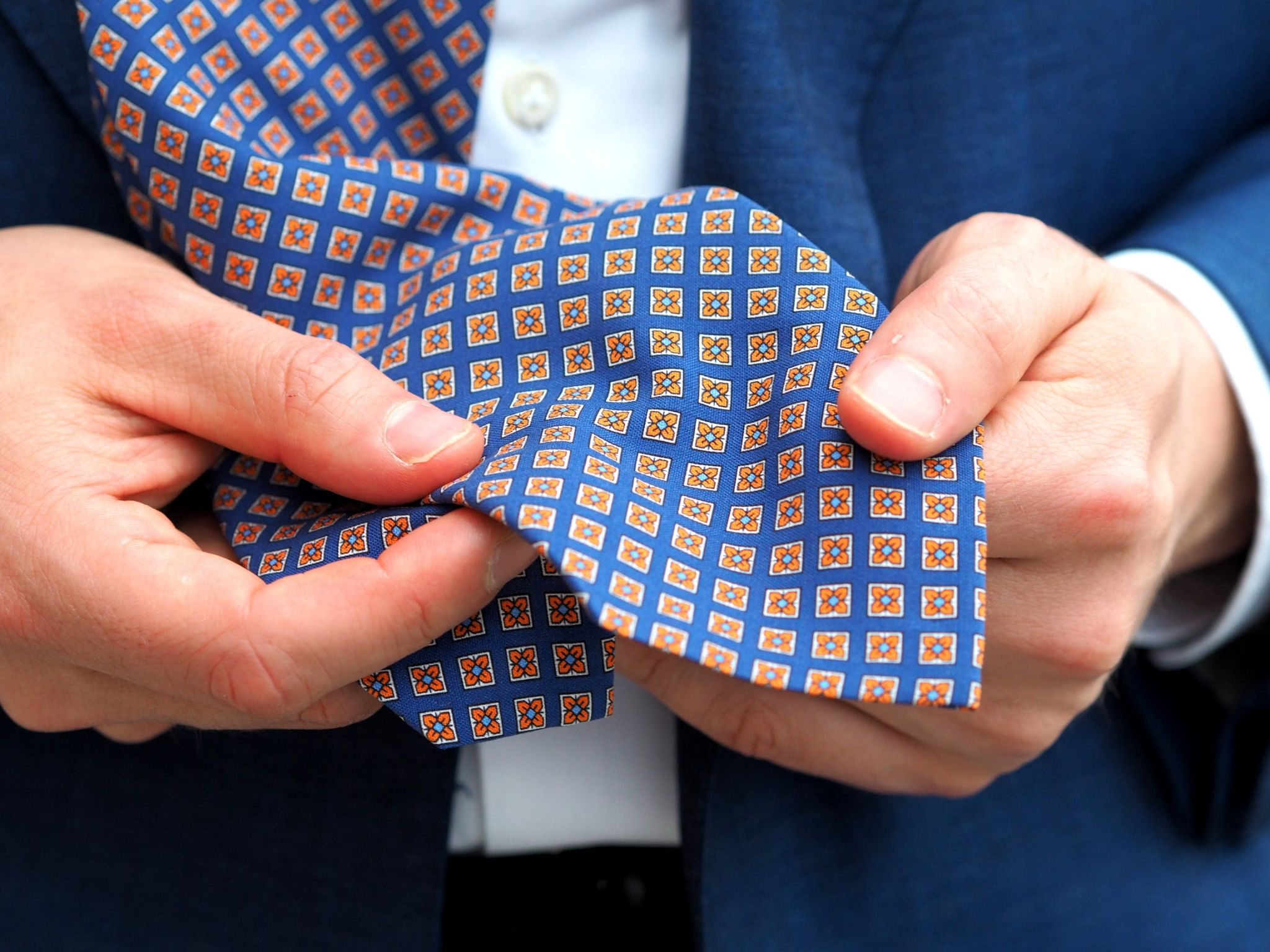 Flower-printed-silk-tie-with-royal-blue-suit