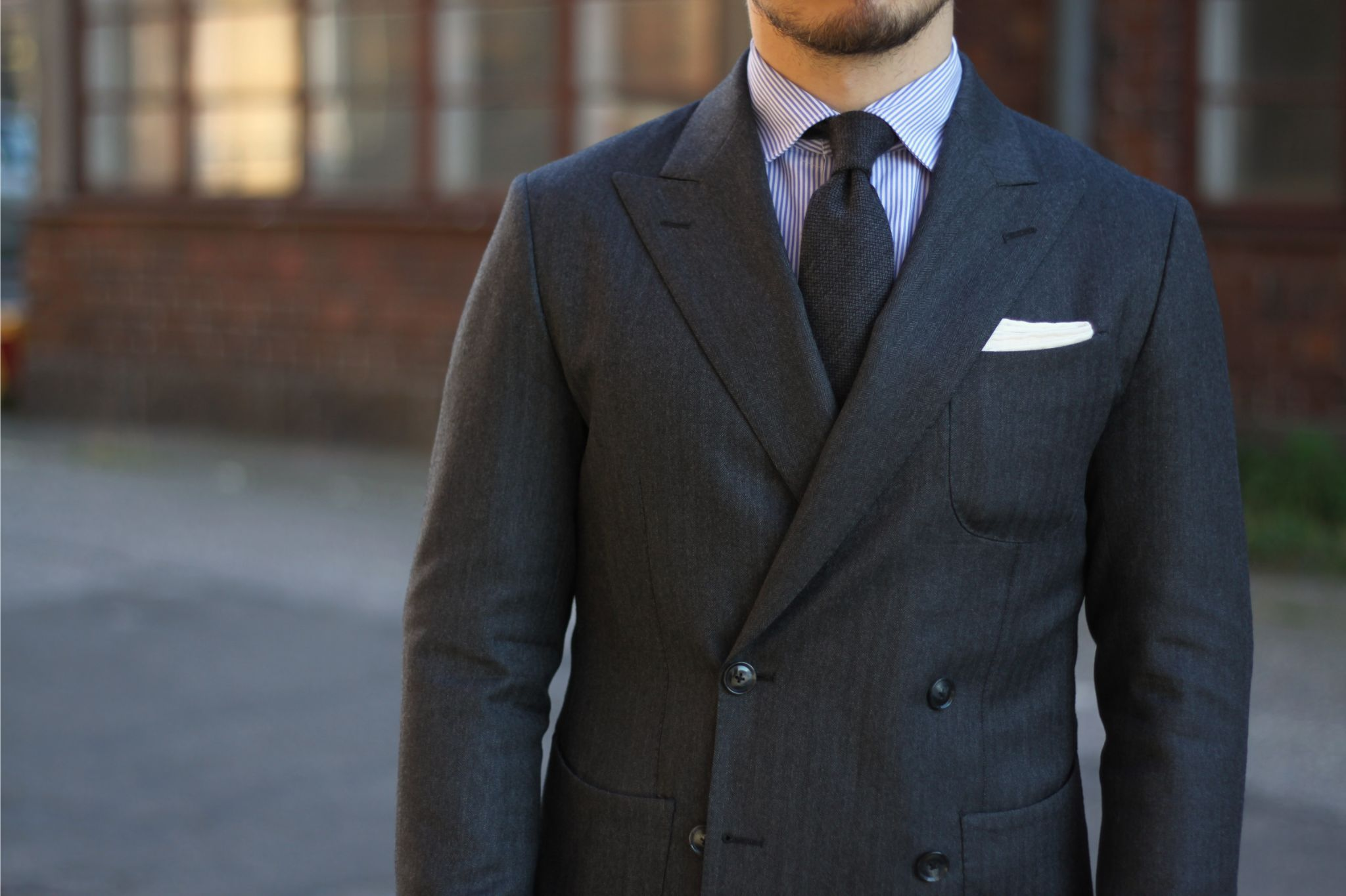 Gray double-breasted suit with a gray tie