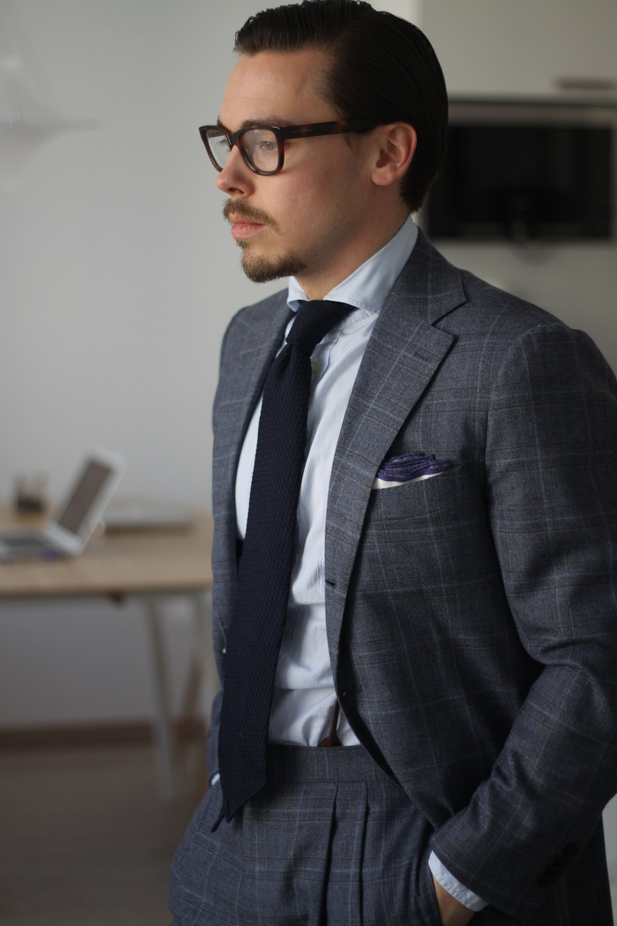 Gray suit with dark blue grenadine tie