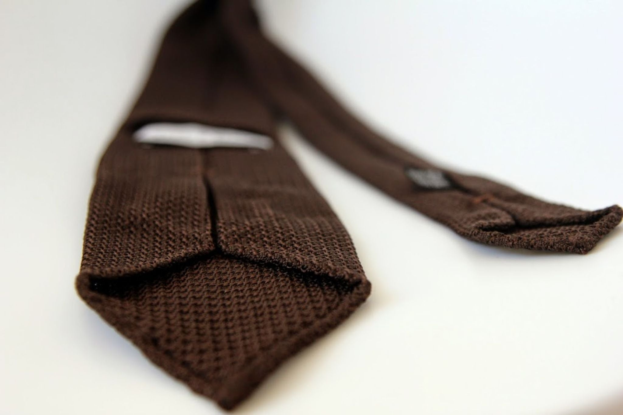 How to tie a tie - details of brown grenadine silk tie.