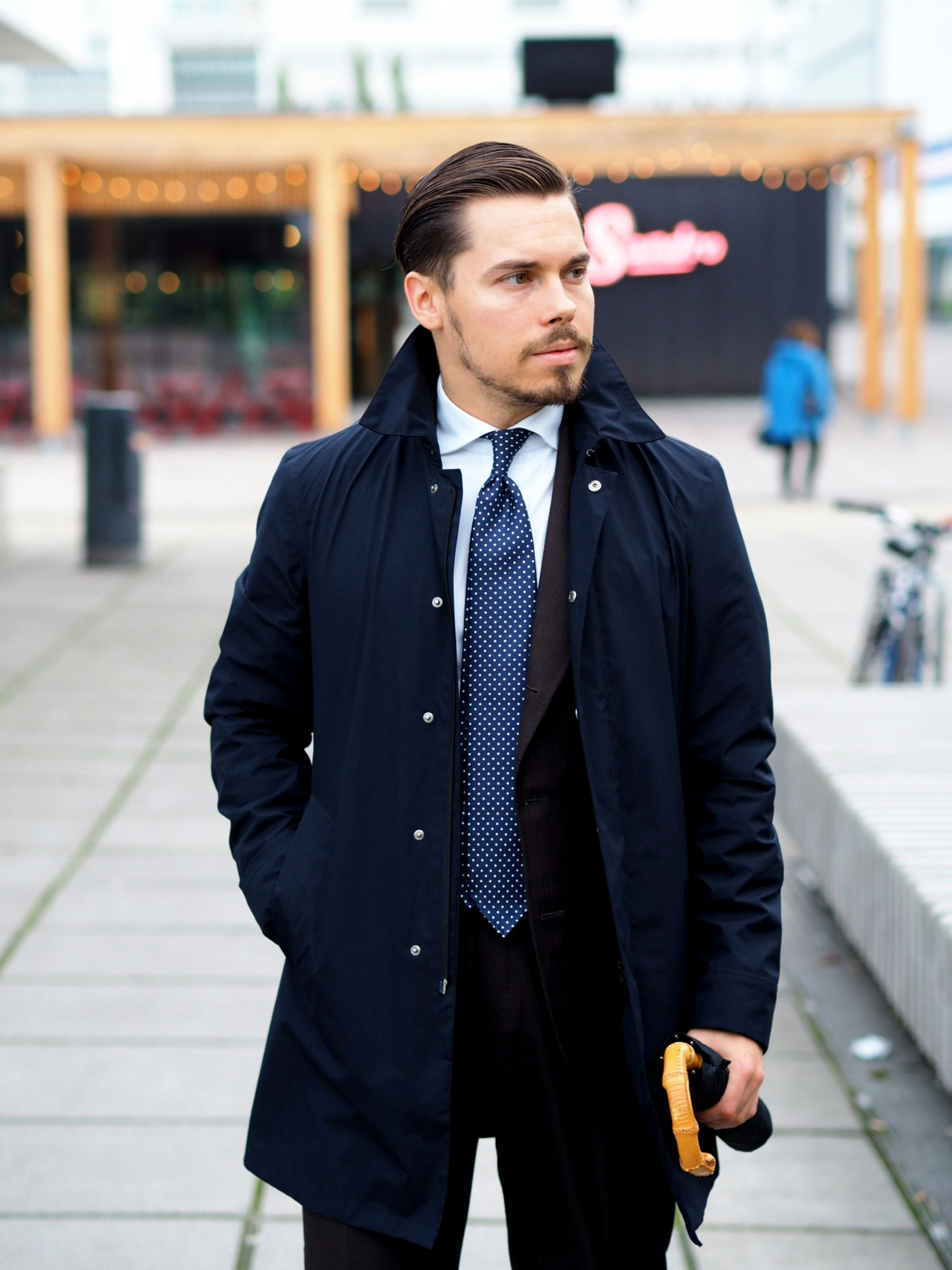 The classic navy blue rain mac with business suit