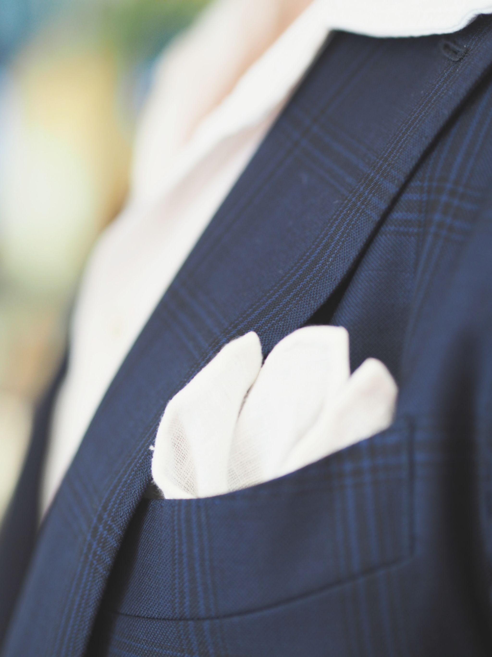 How to wear the same suit in different ways - white linen pocket square details.