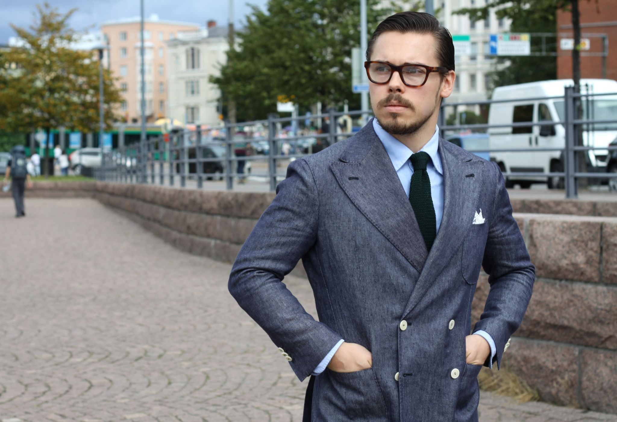 Double-breasted blazer with cotton trousers and knitted tie
