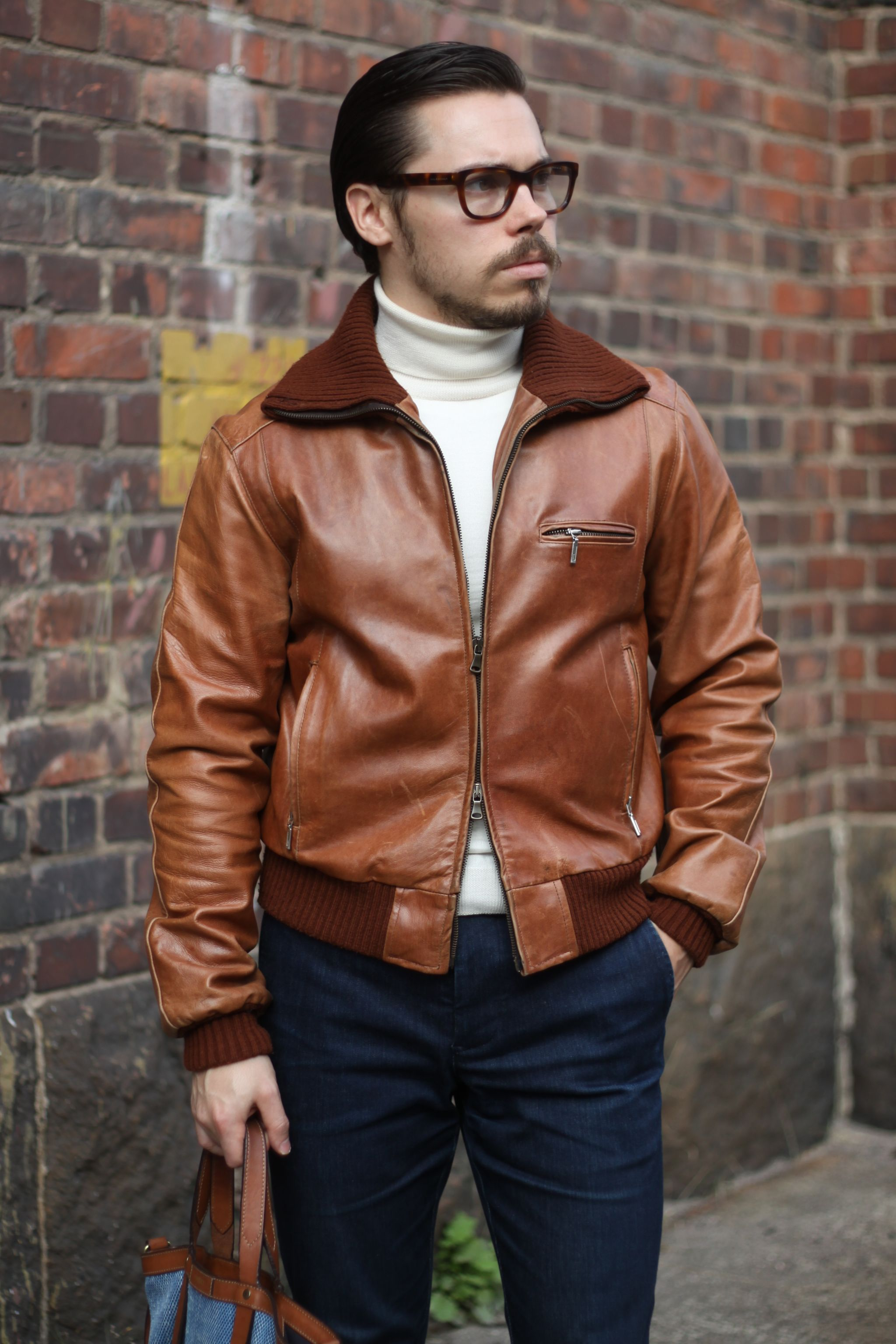 Well-fitted and sharp A-1 leather jacket can be a functional piece when going for a dressed-up casual ensemble.