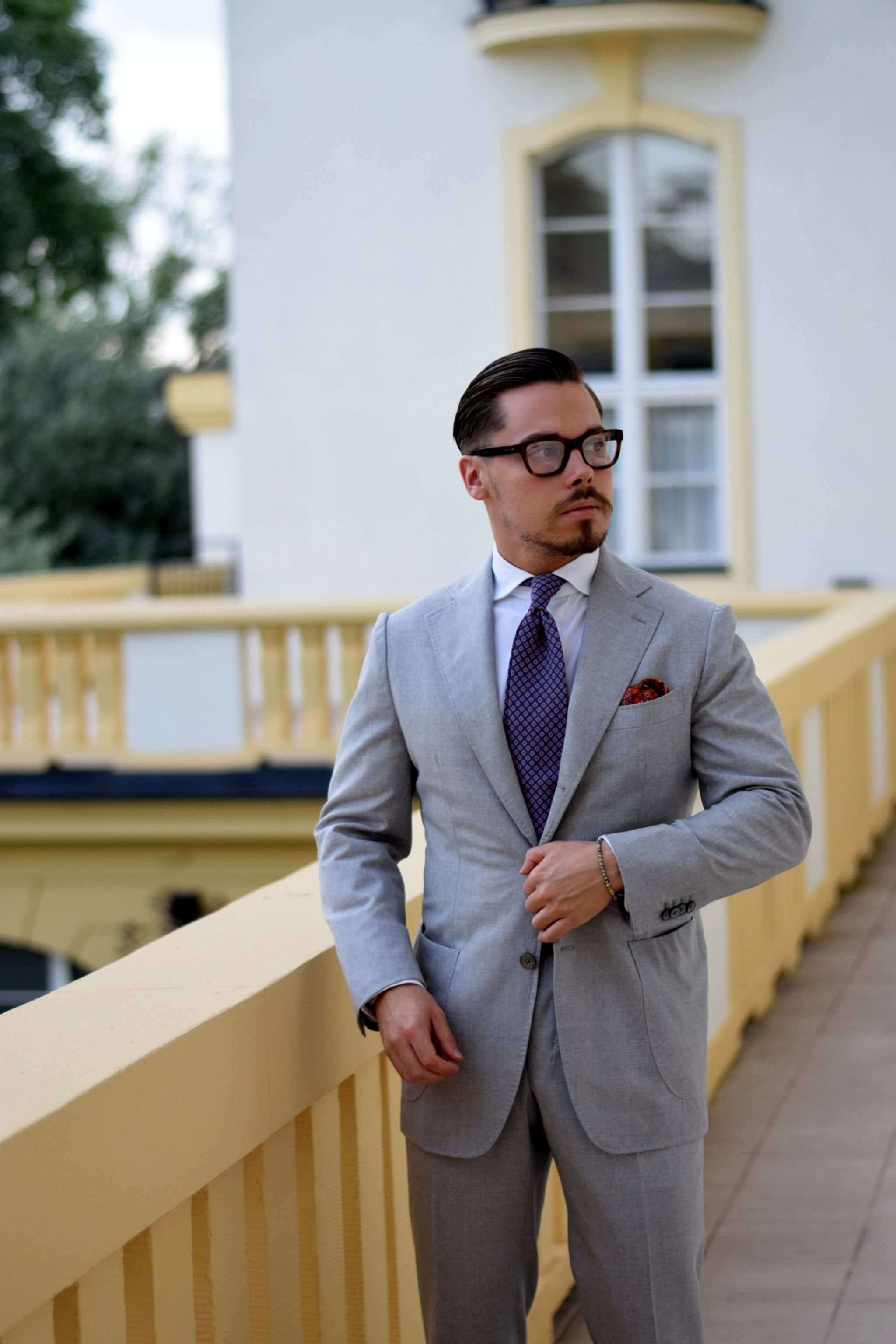 Light gray suit with orange accessories - at the terrace of Grand Sofitel Sopot