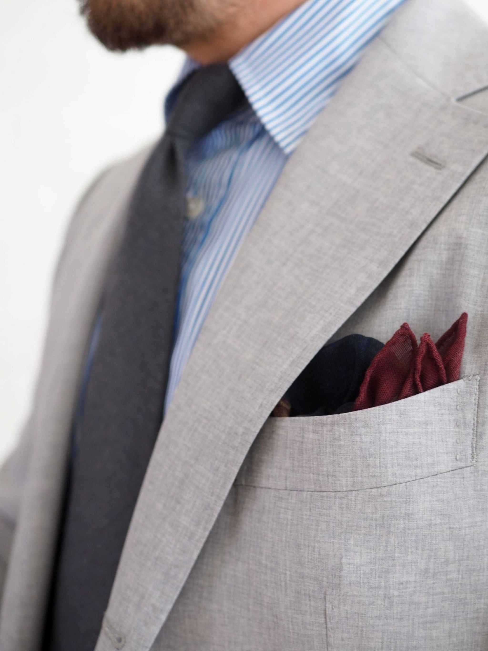 Favorite suits - DLA symposium pocket square with the gray suit and gray wool tie