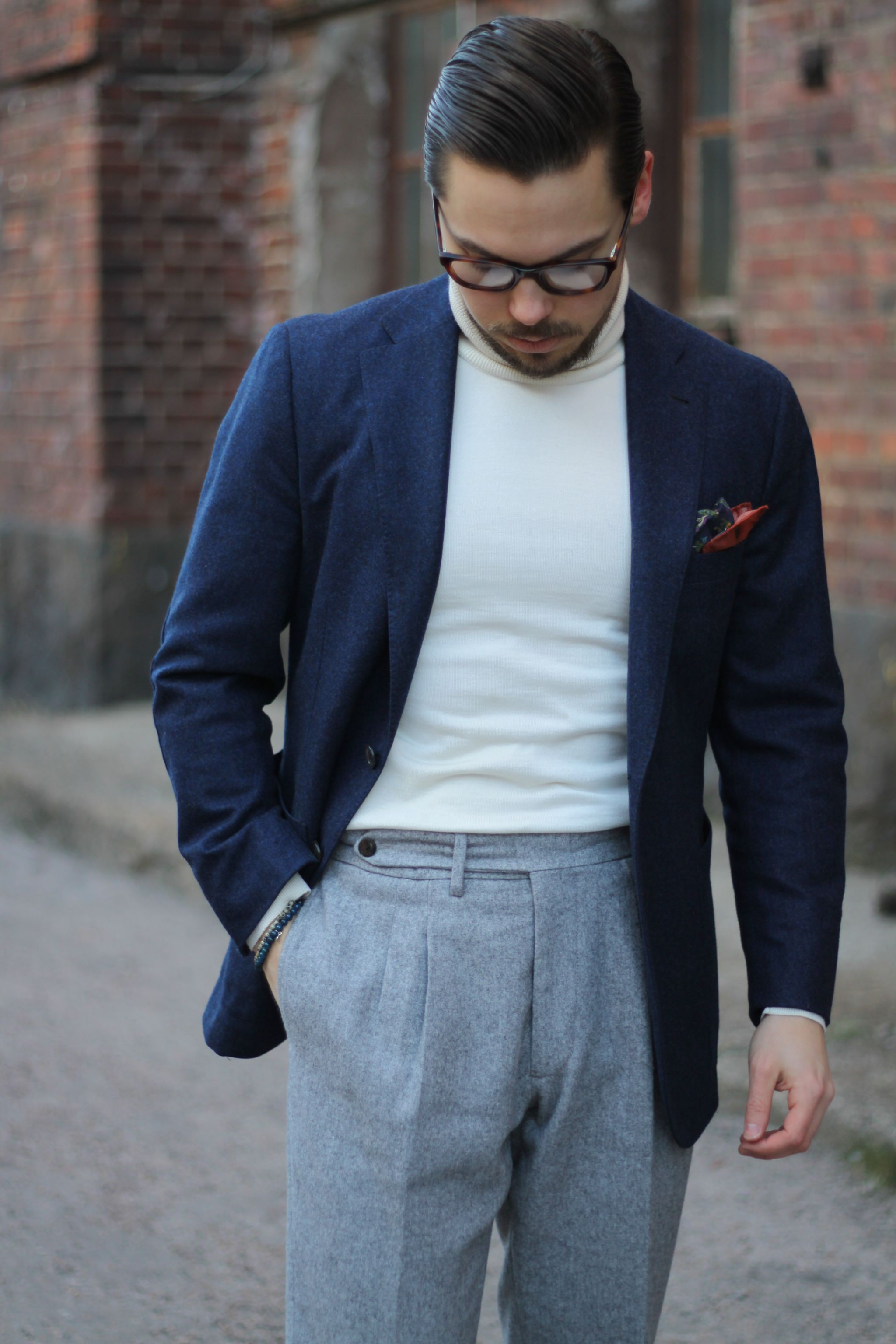 Light grey flannel trousers with pleats made by Finealta