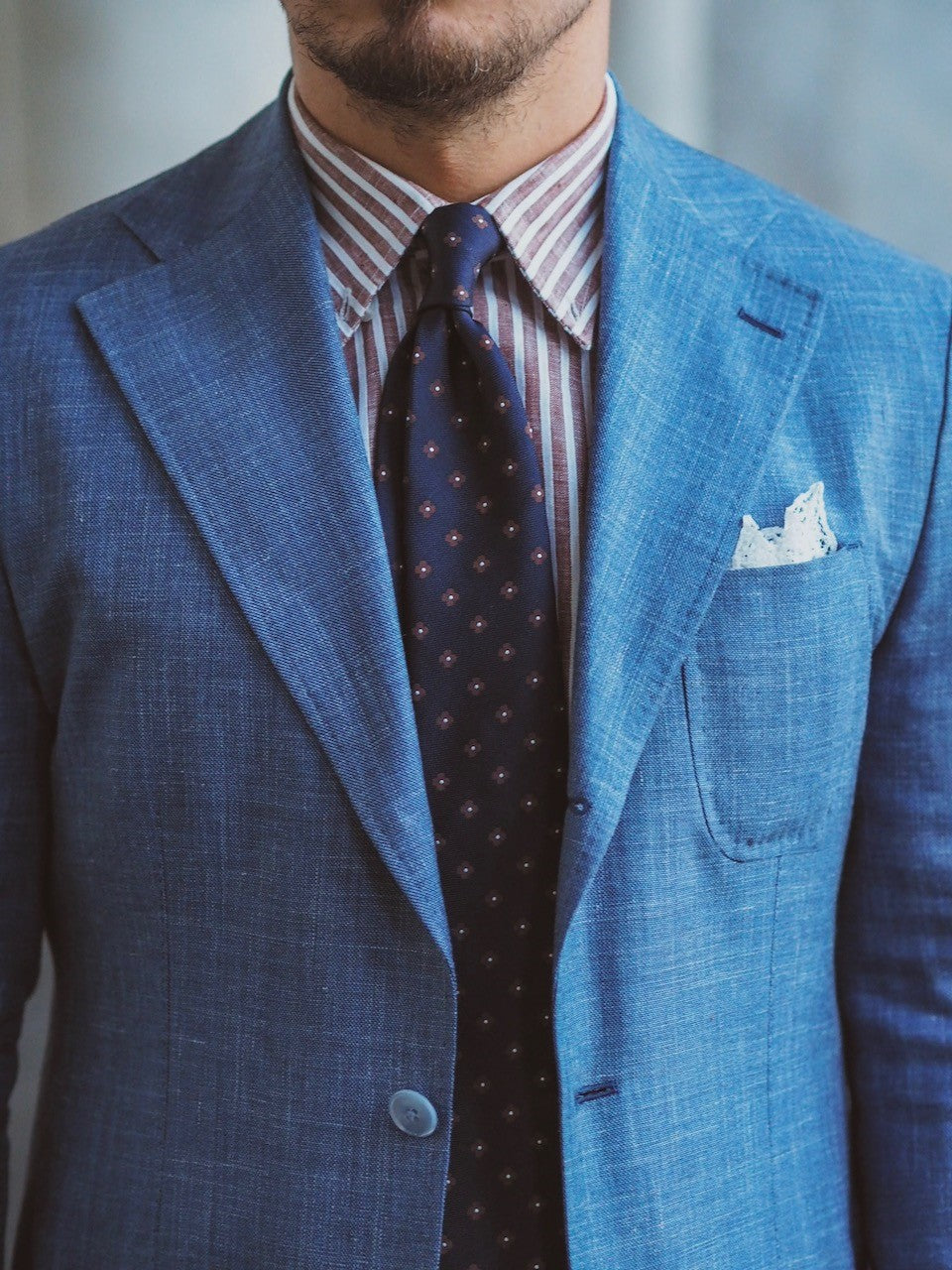 Light blue suit and striped shirt details