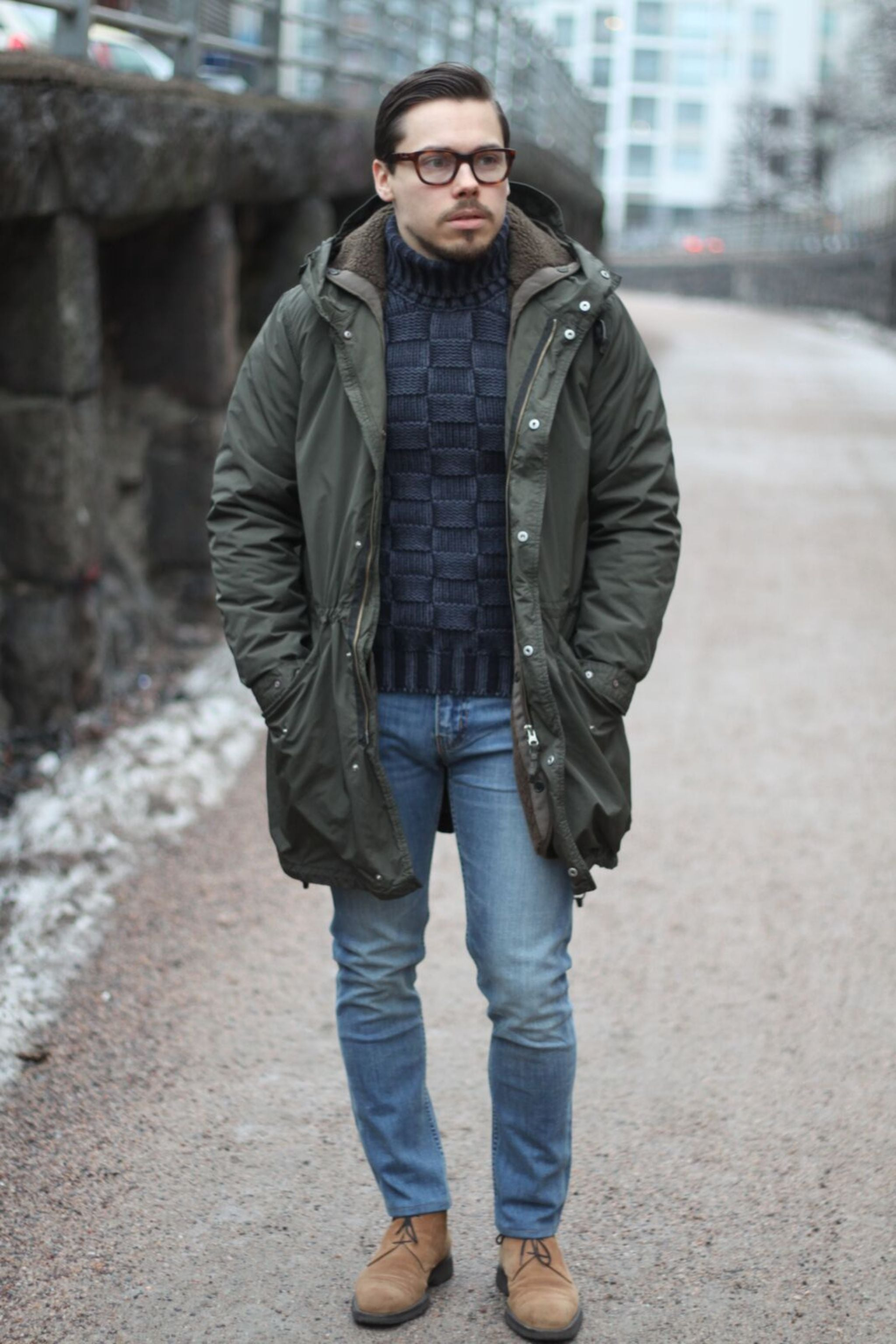 Military green Aspesi Lambrettone parka jacket with light colored denim