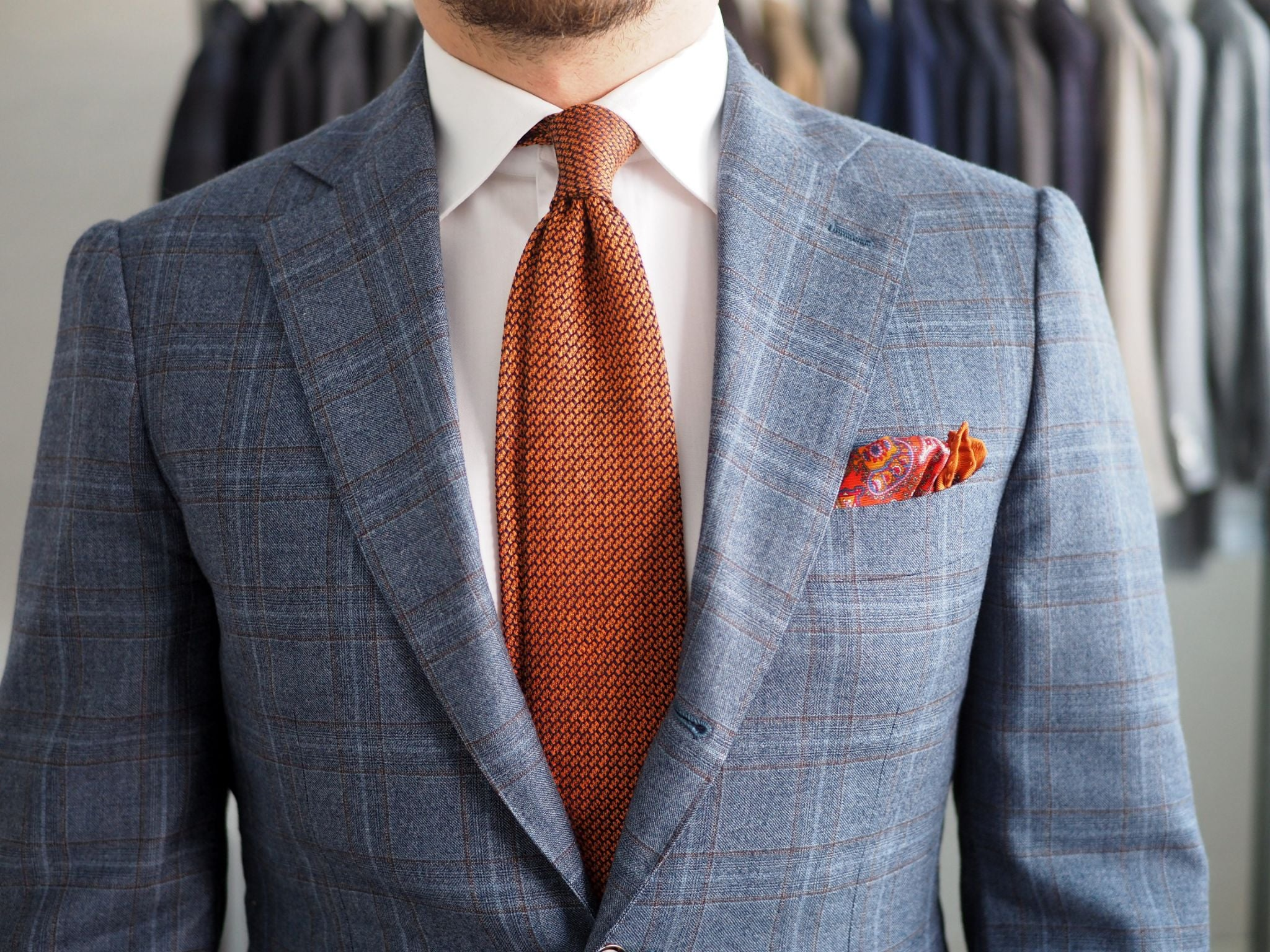 Details - orange tie with white shirt and checked suit