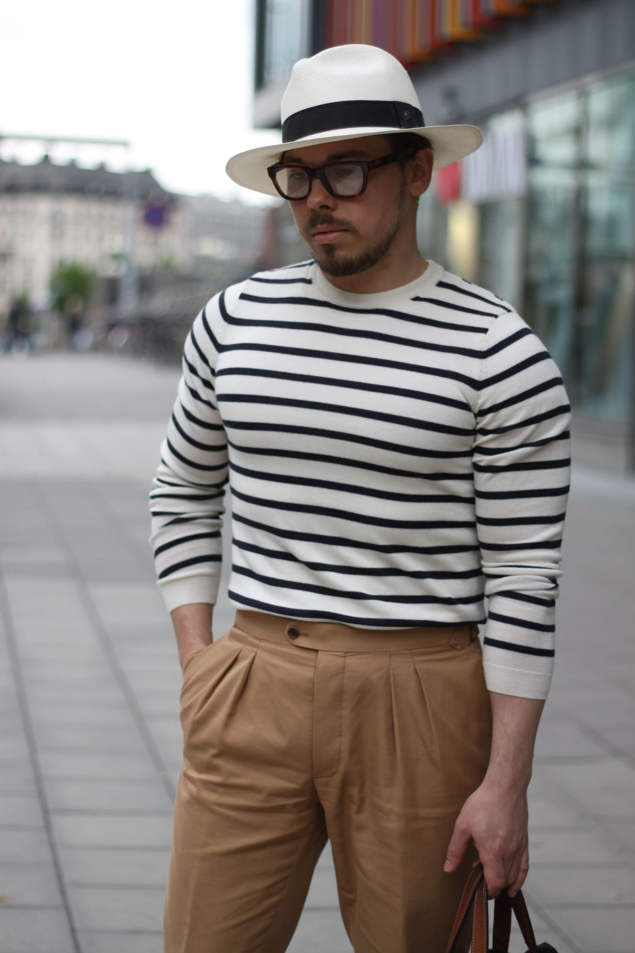 Panama hat with striped shirt and cotton slacks