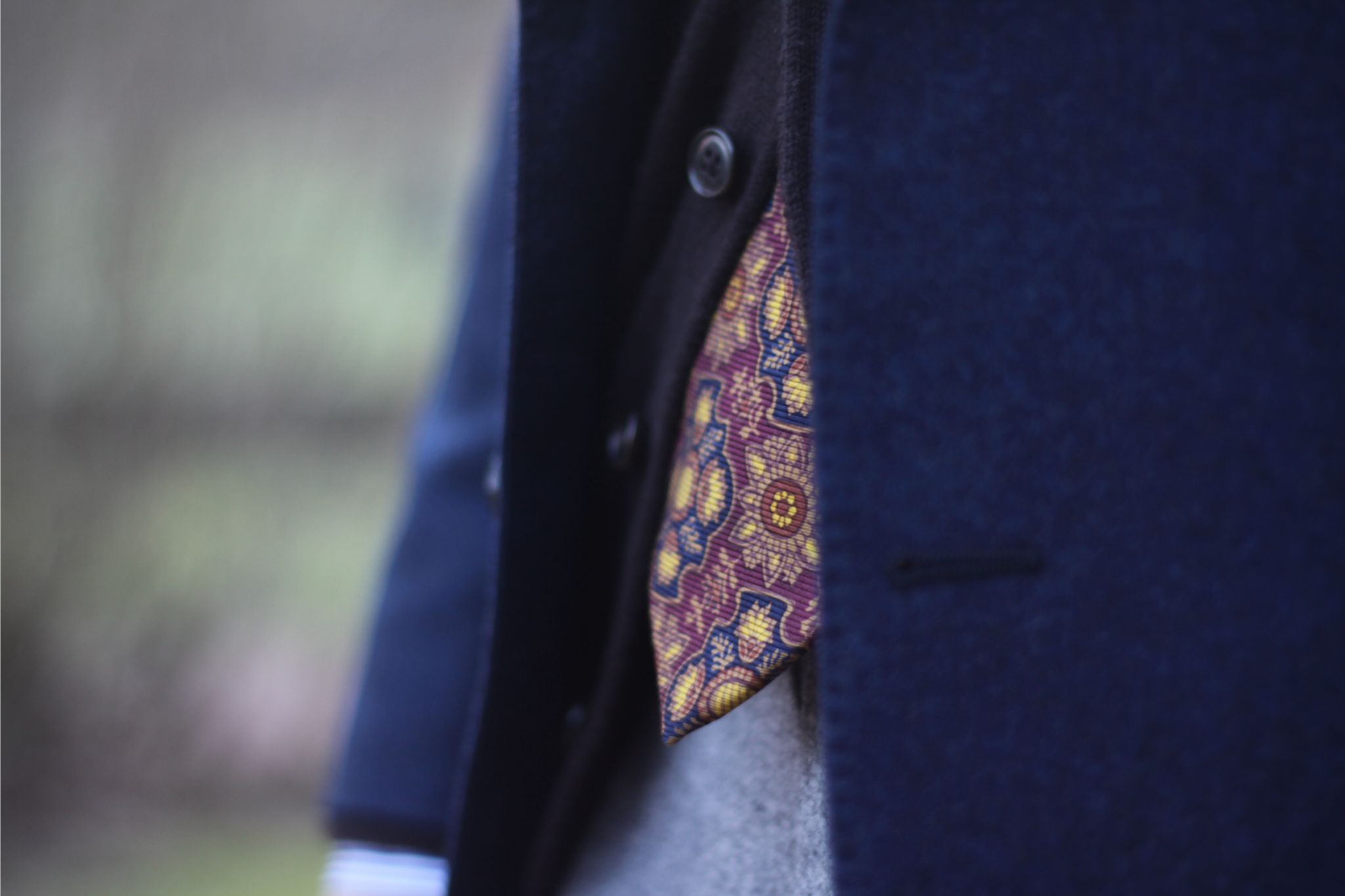 Patterned silk tie with cashmere cardigan