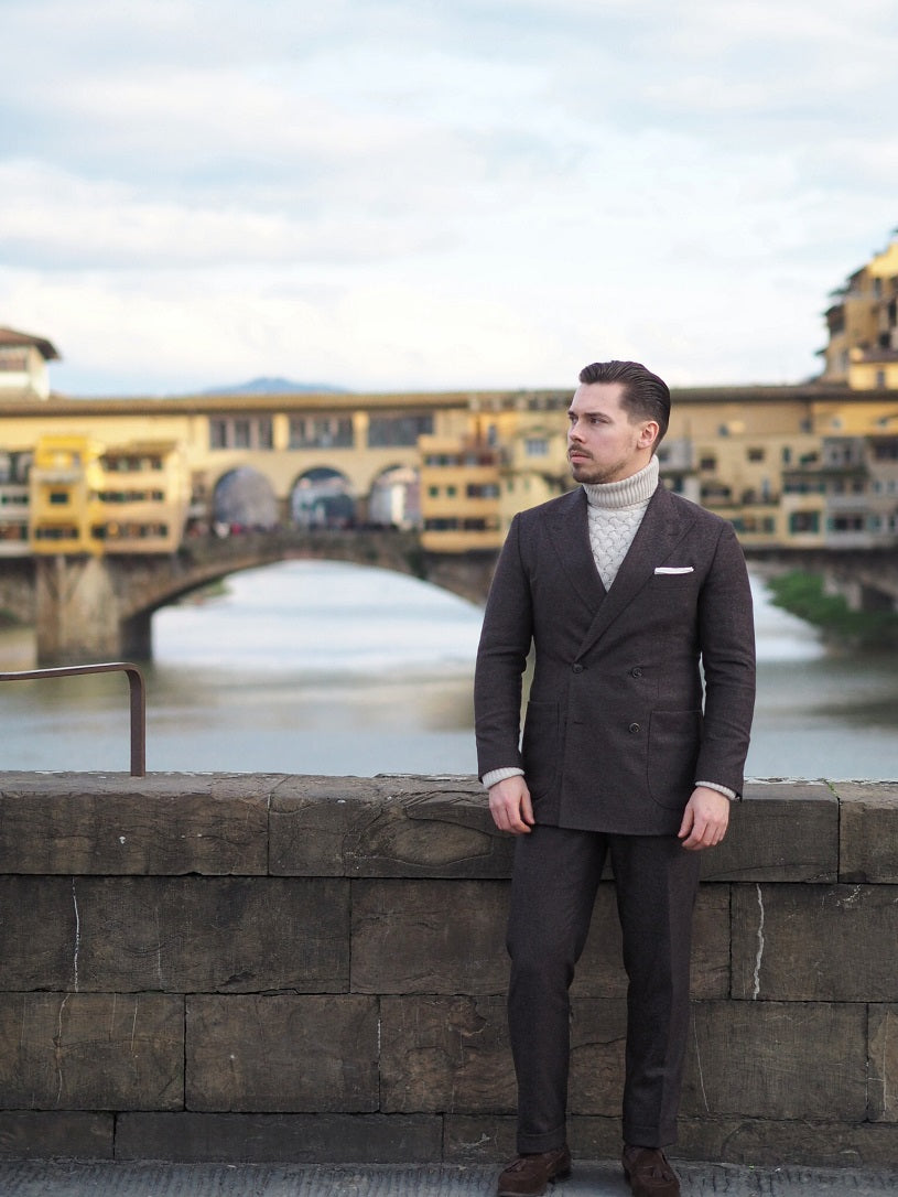 Brown double-breasted suit with oatmeal colored roll neck sweater at Ponte Vechio in Florence