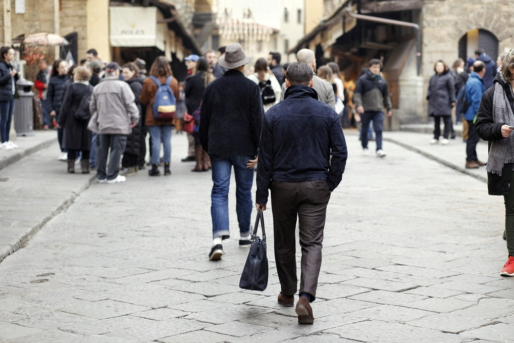 Walking on the streets of Florence - wearing the Stoffa navy suede flight jacket