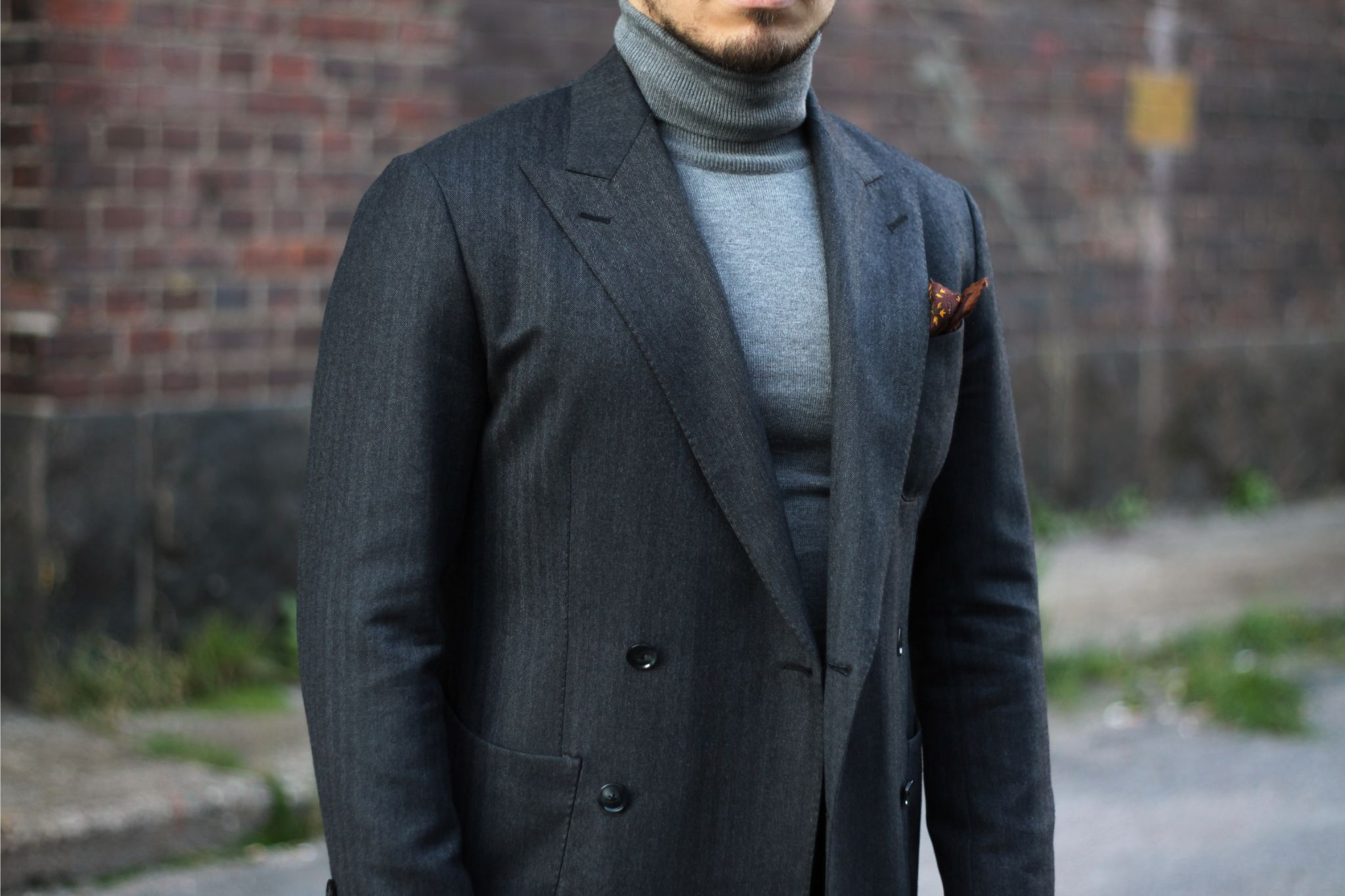 How to dress down a suit - light gray roll neck sweater with mid-gray herringbone wool suit