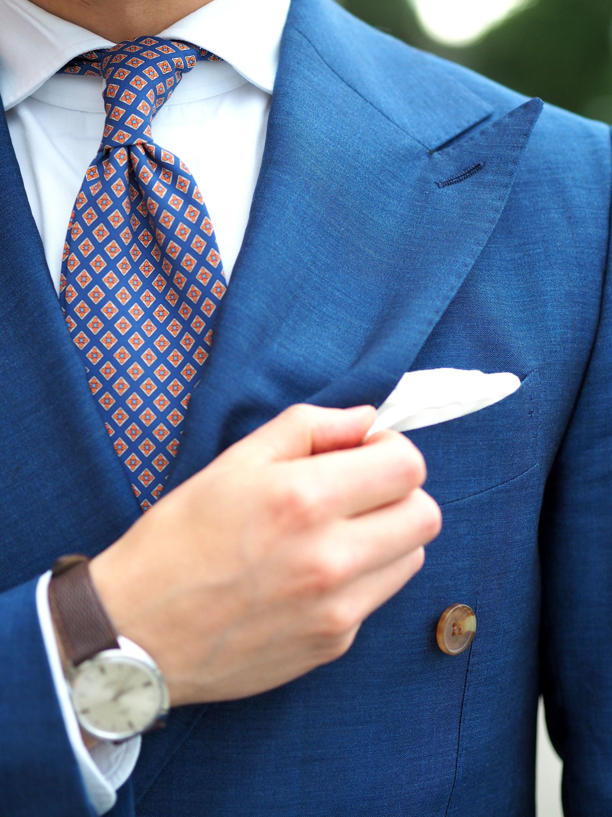 Royal-blue-suit-with-printed-tie-and-white-linen-pocket-square