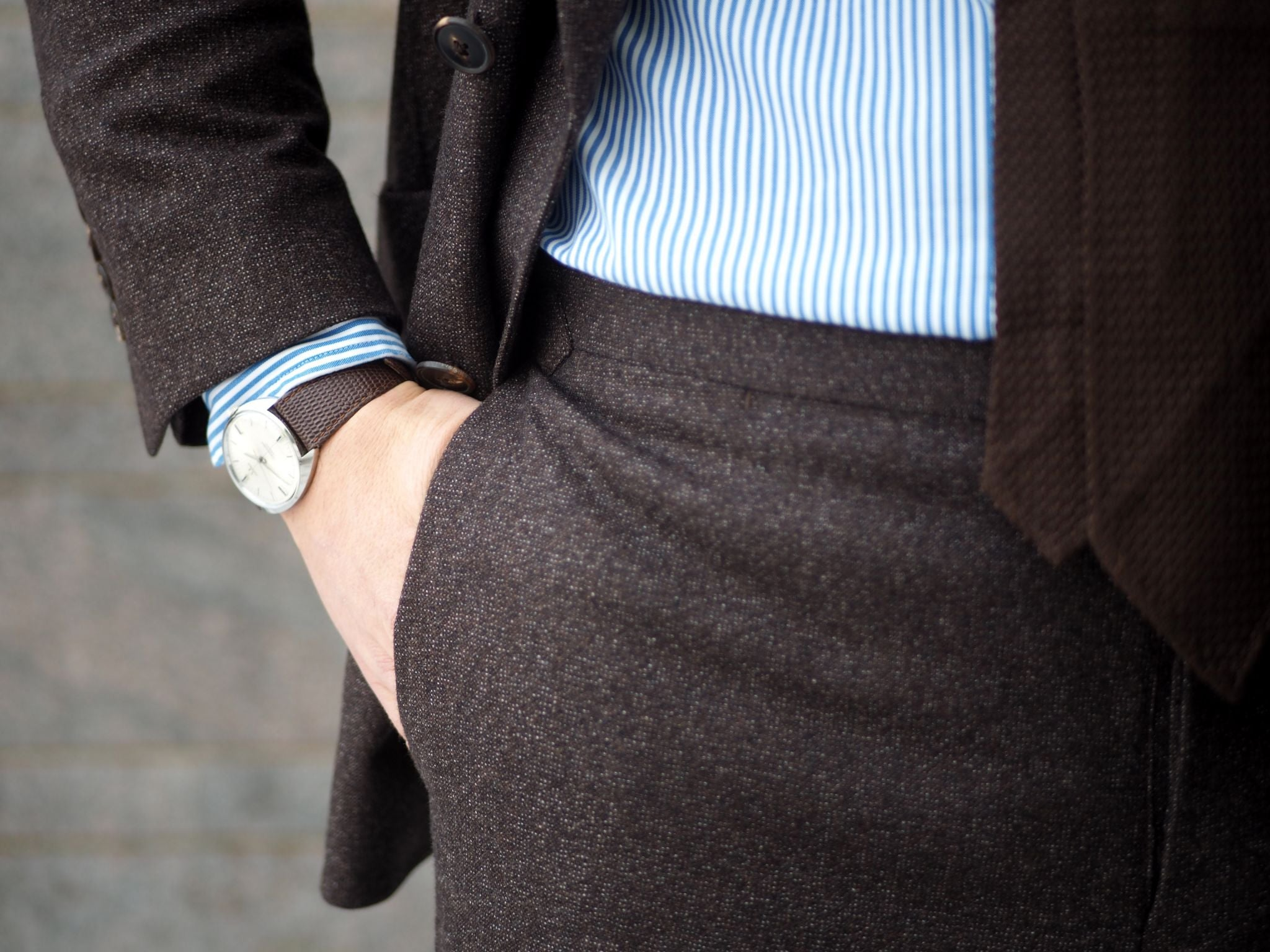 Details - brown leather watch strap to match the outfit colors and brown suit.
