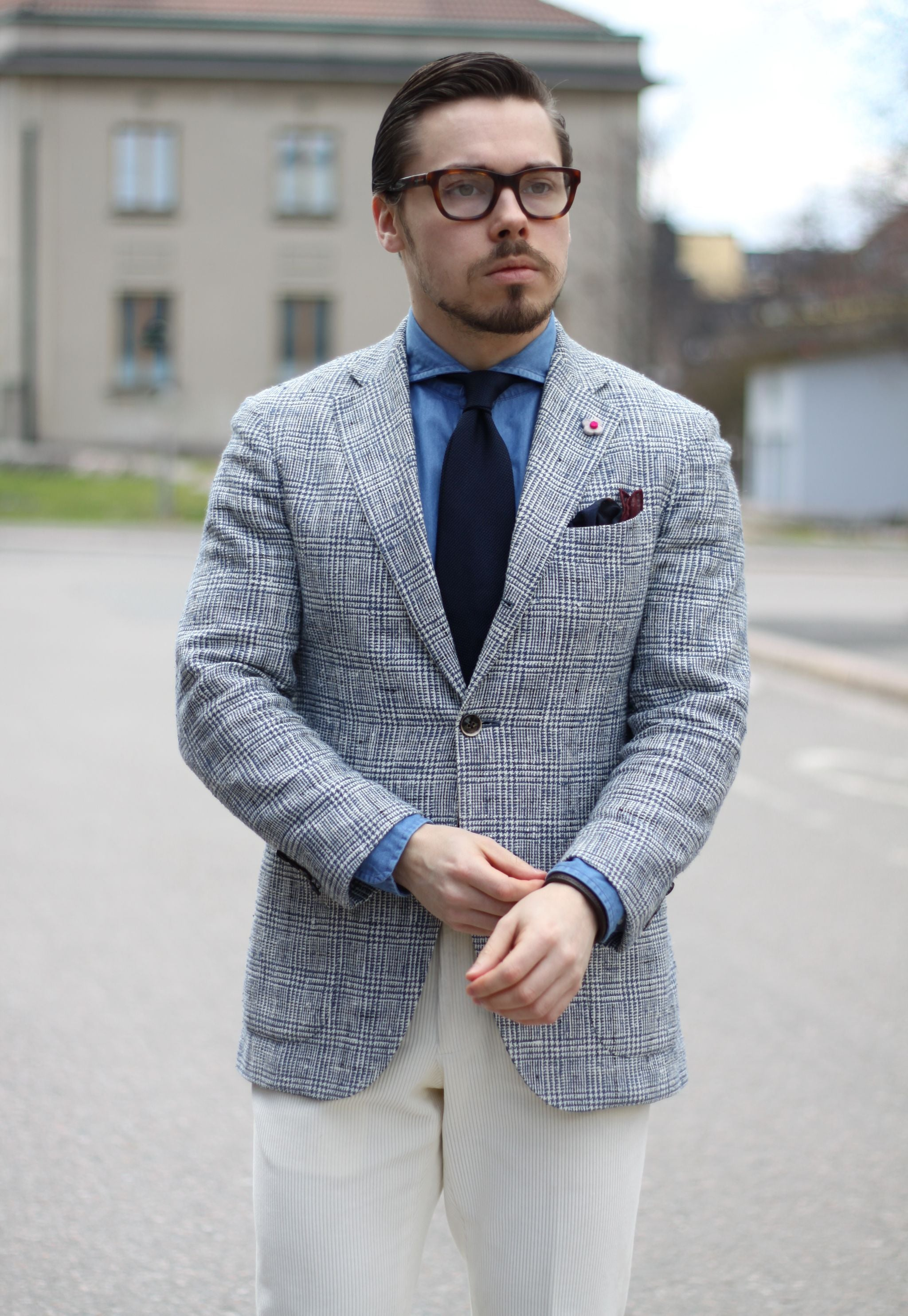 Checked Lardini sport coat with denim shirt and blue tie
