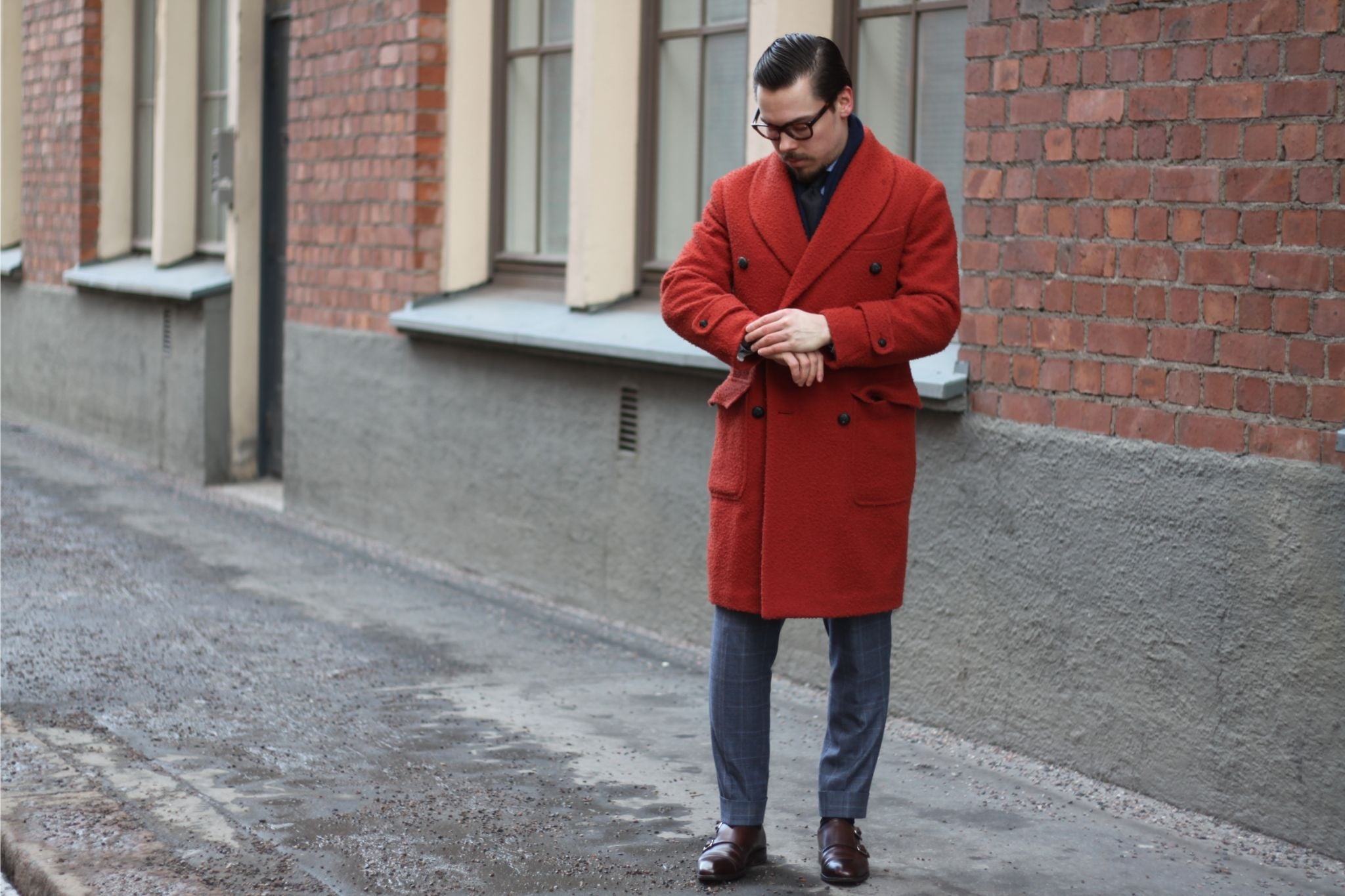 Shawl collar overcoat worn with a gray suit, navy cashmere scarf and brown double monk shoes