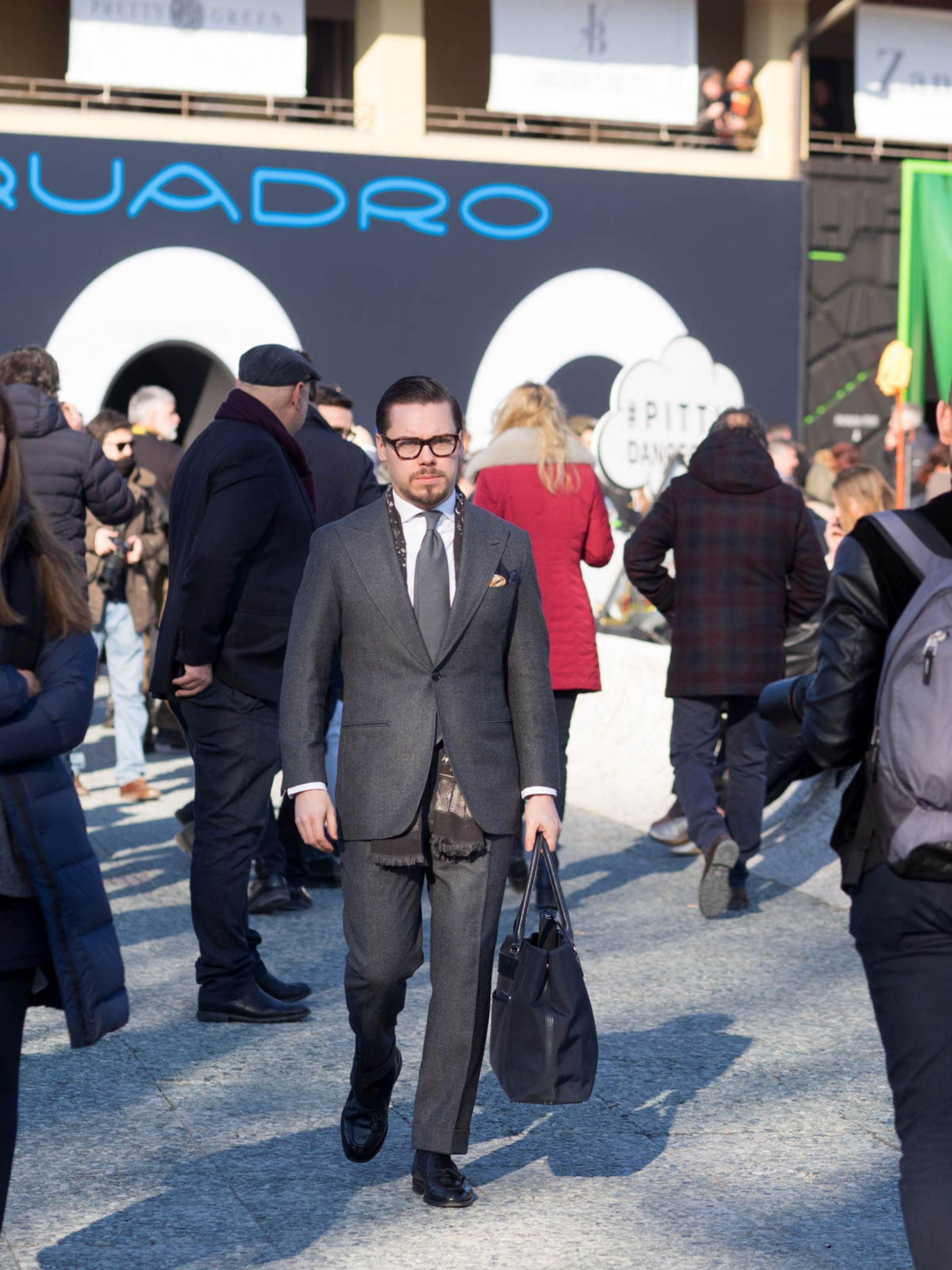 The gray one button suit with DLA gray wool tie, white shirt and black tassel loafers on the first day of Pitti Uomo 91.