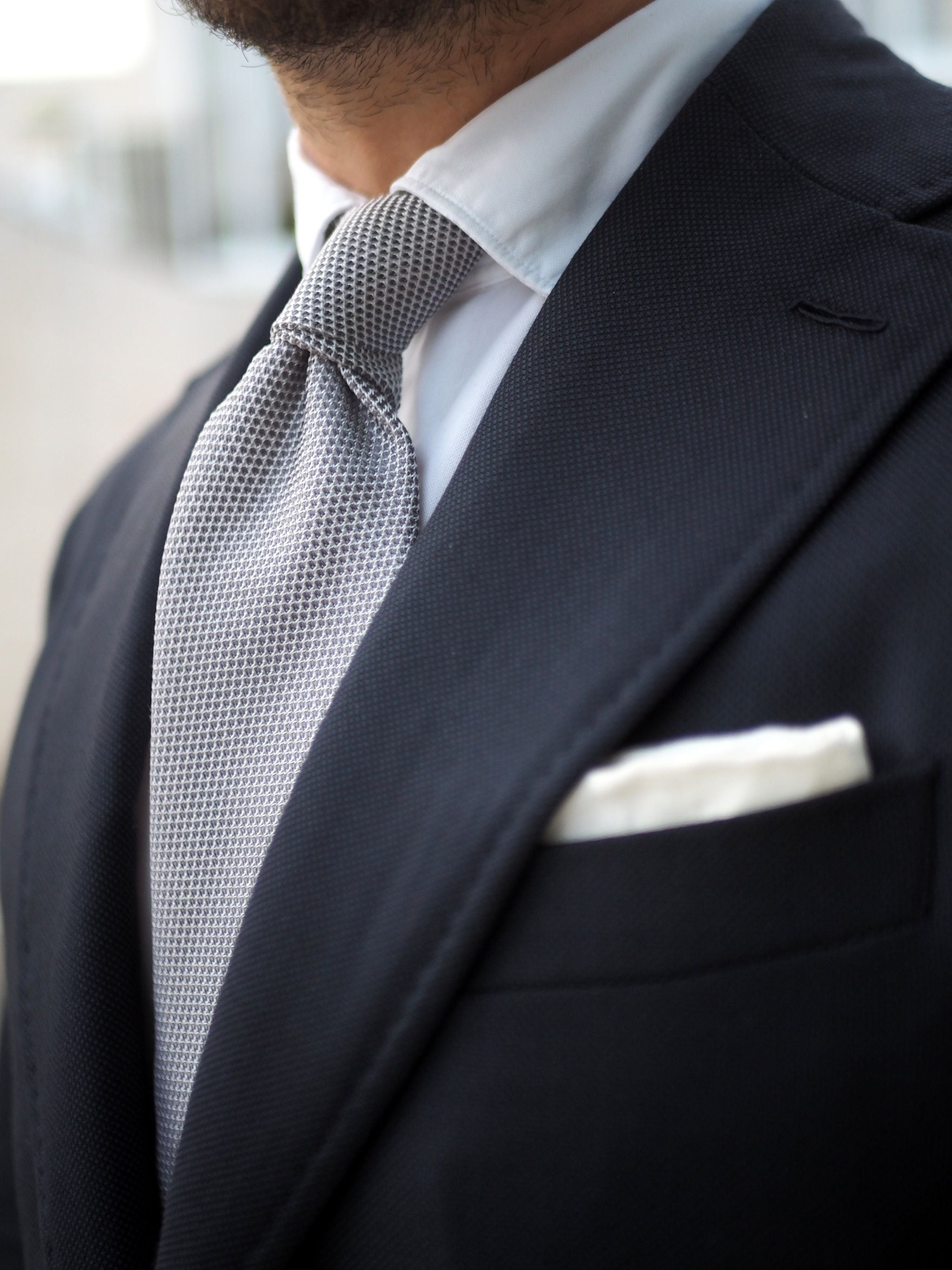 What to wear for wedding party - silver grenadine tie with double four-in-hand knot