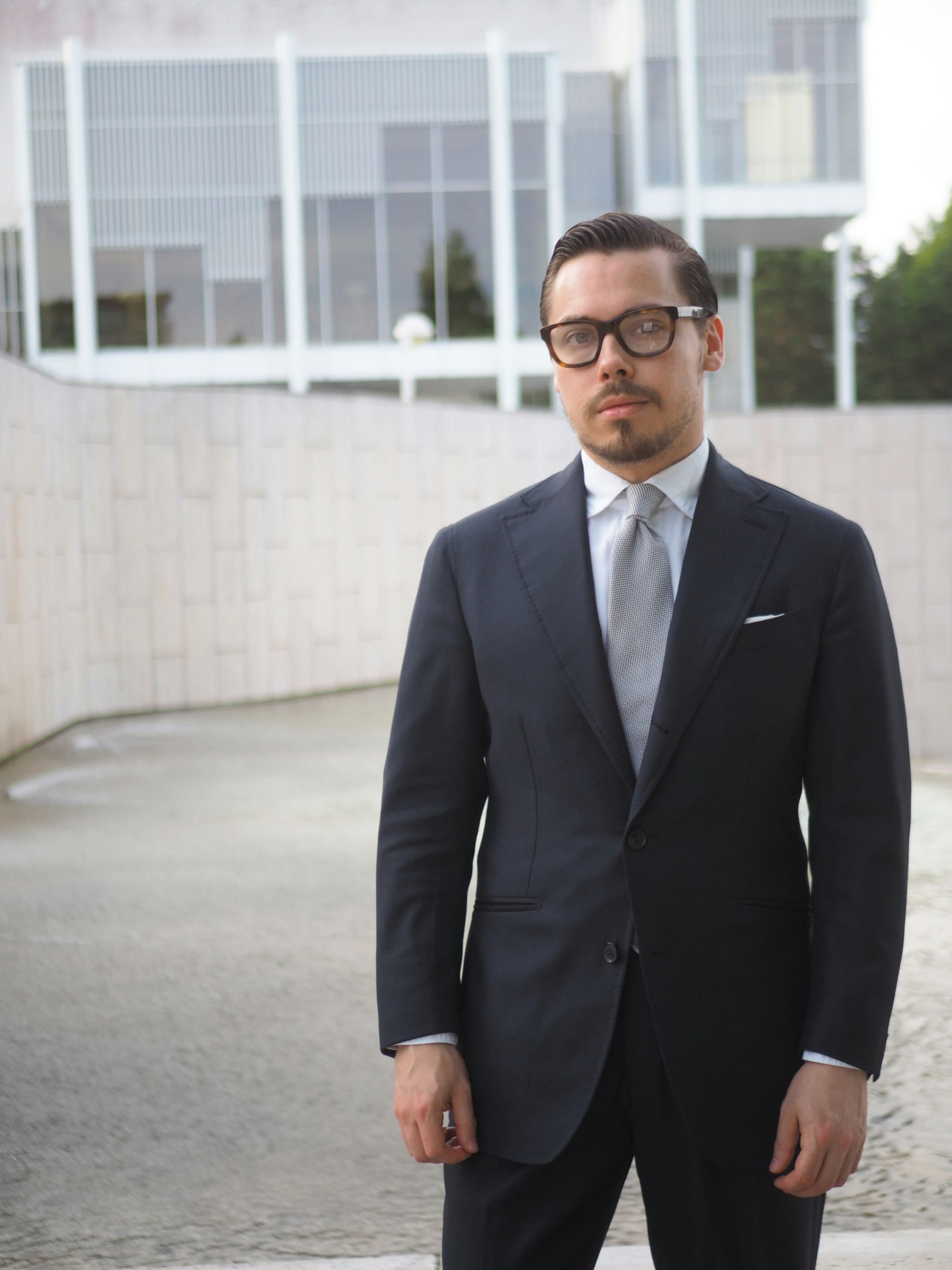 What to wear for wedding party - Blue suit with silver grenadine tie and white shirt.