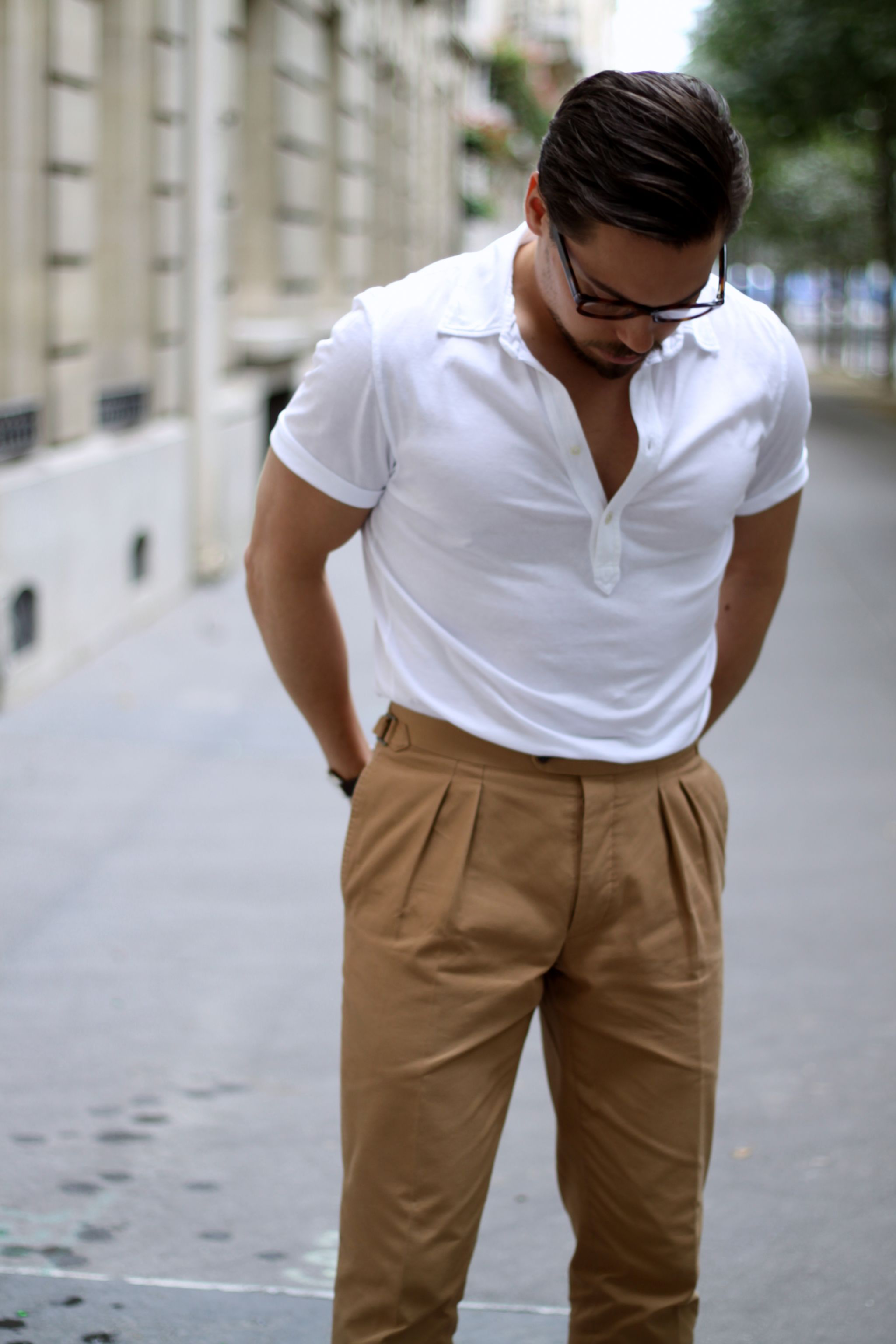 White polo shirt with camel colored cotton trousers