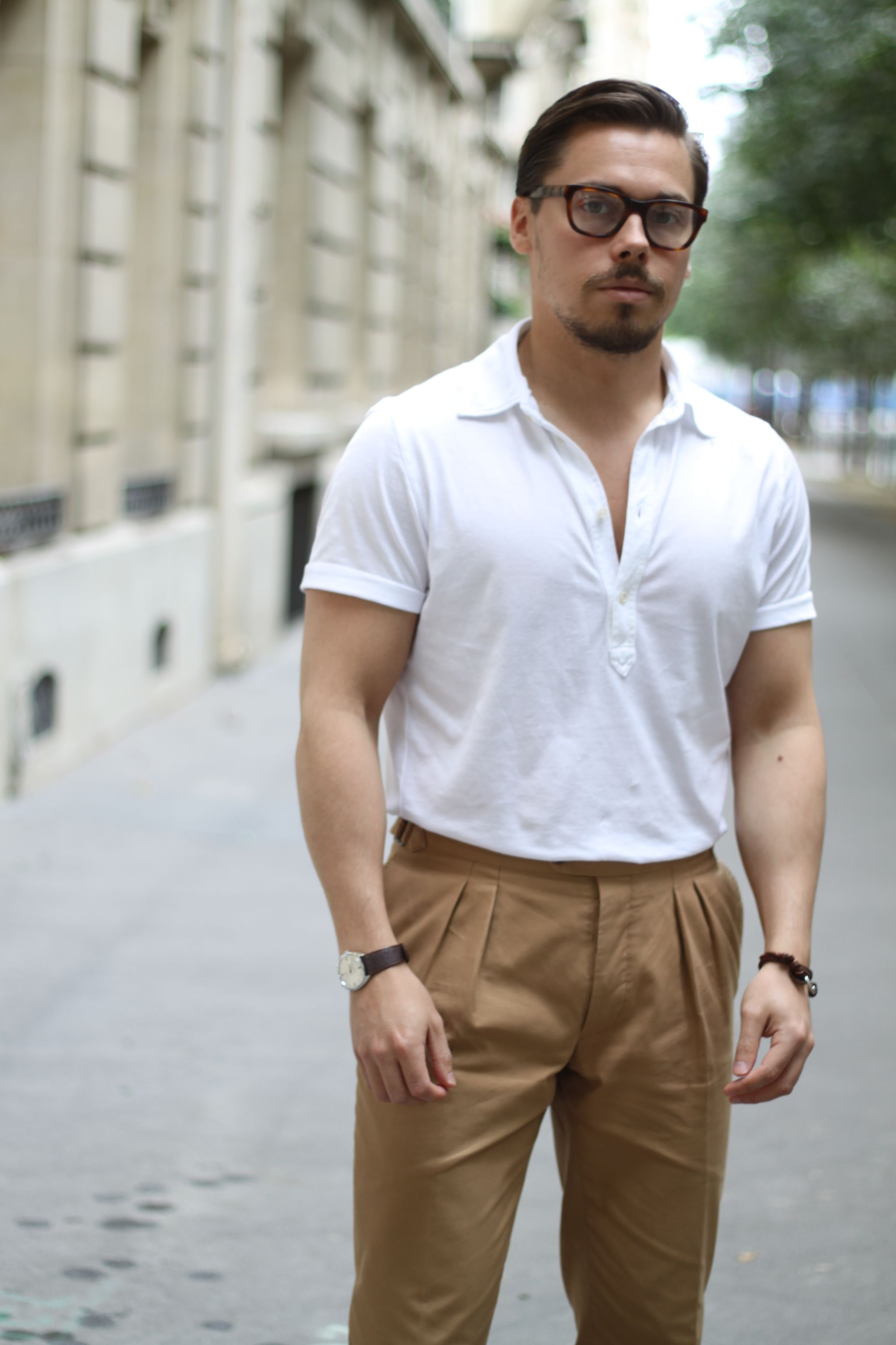 White short sleeve polo shirt and pleated trousers