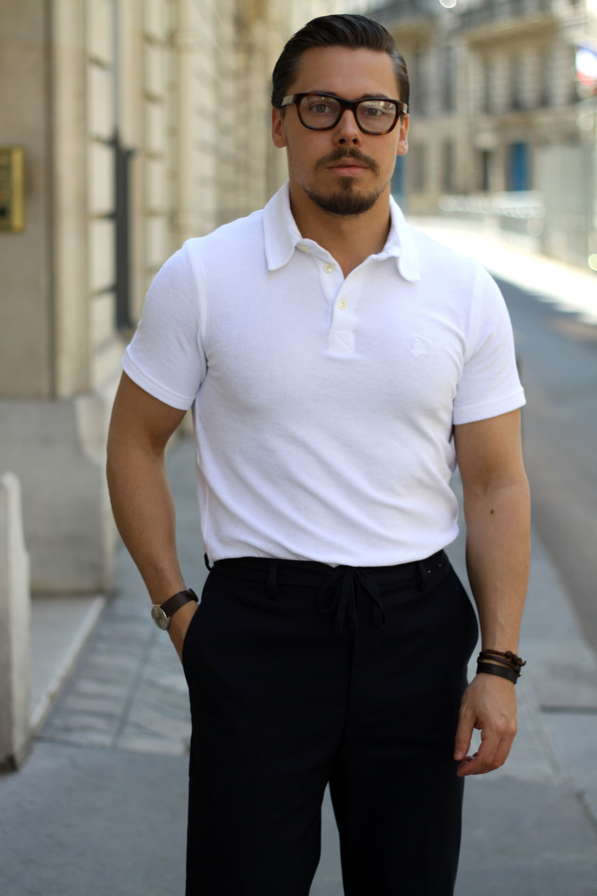White toweling cloth polo shirt with dark blue trousers