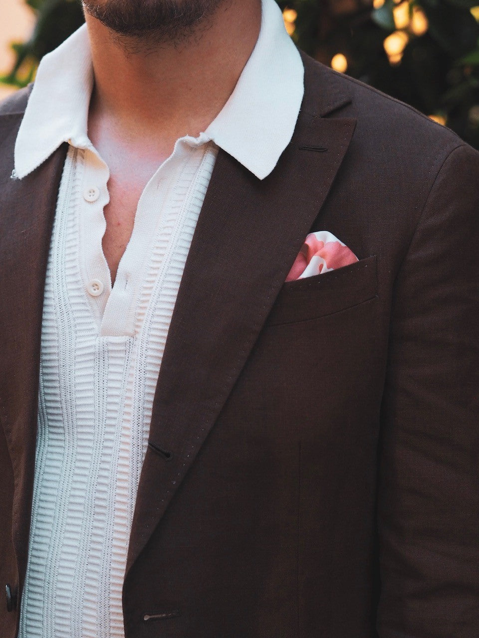 White knitted polo shirt with brown linen suit jacket details and textures