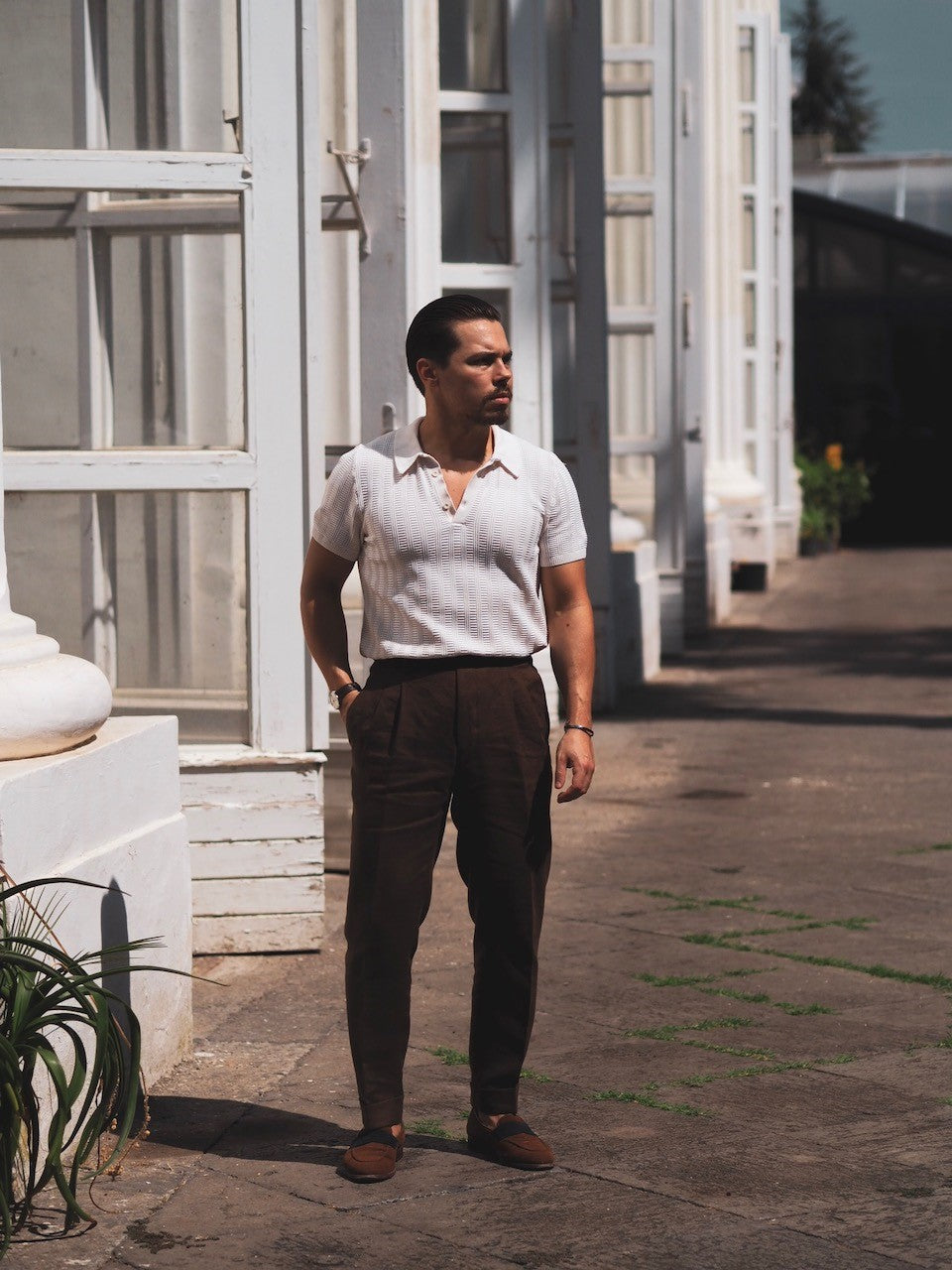 White knitted polo shirt with brown linen trousers