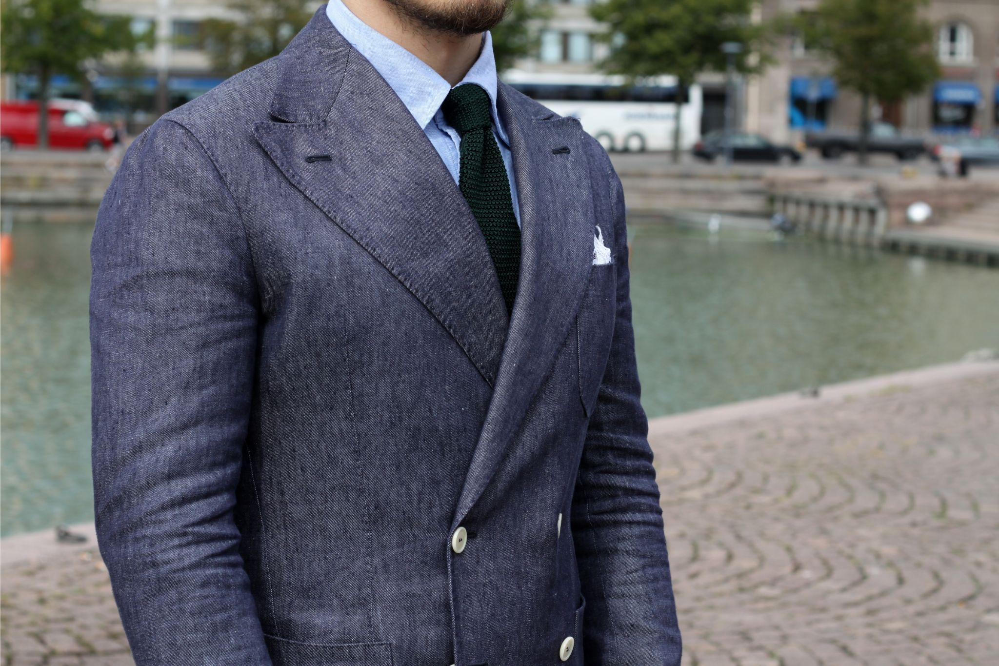 bottle green knitted tie with linen blazer