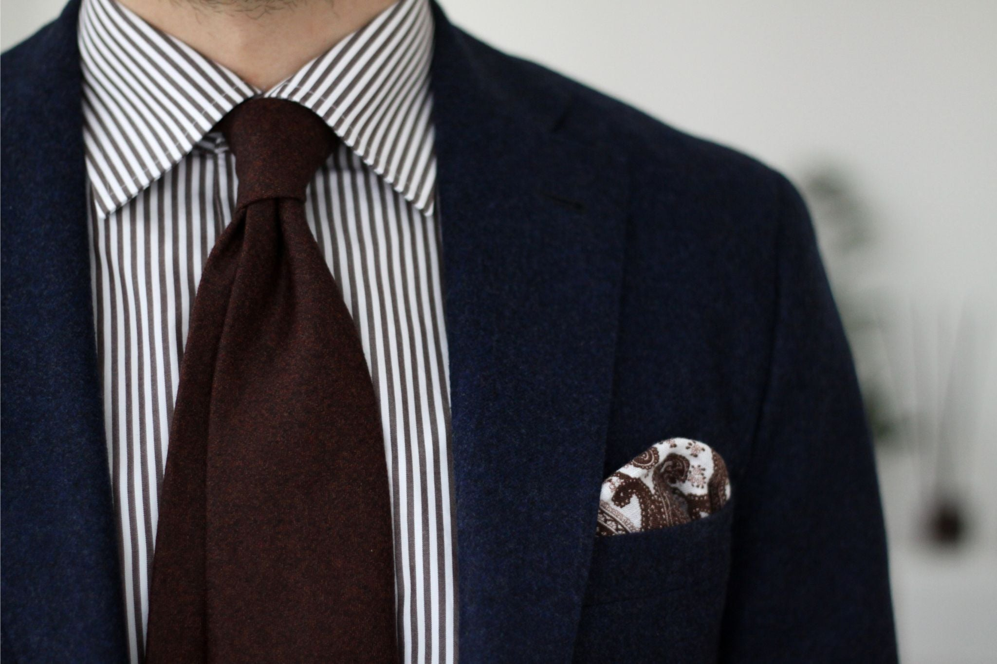 Brown tie with double-four-in-hand knot and dimple