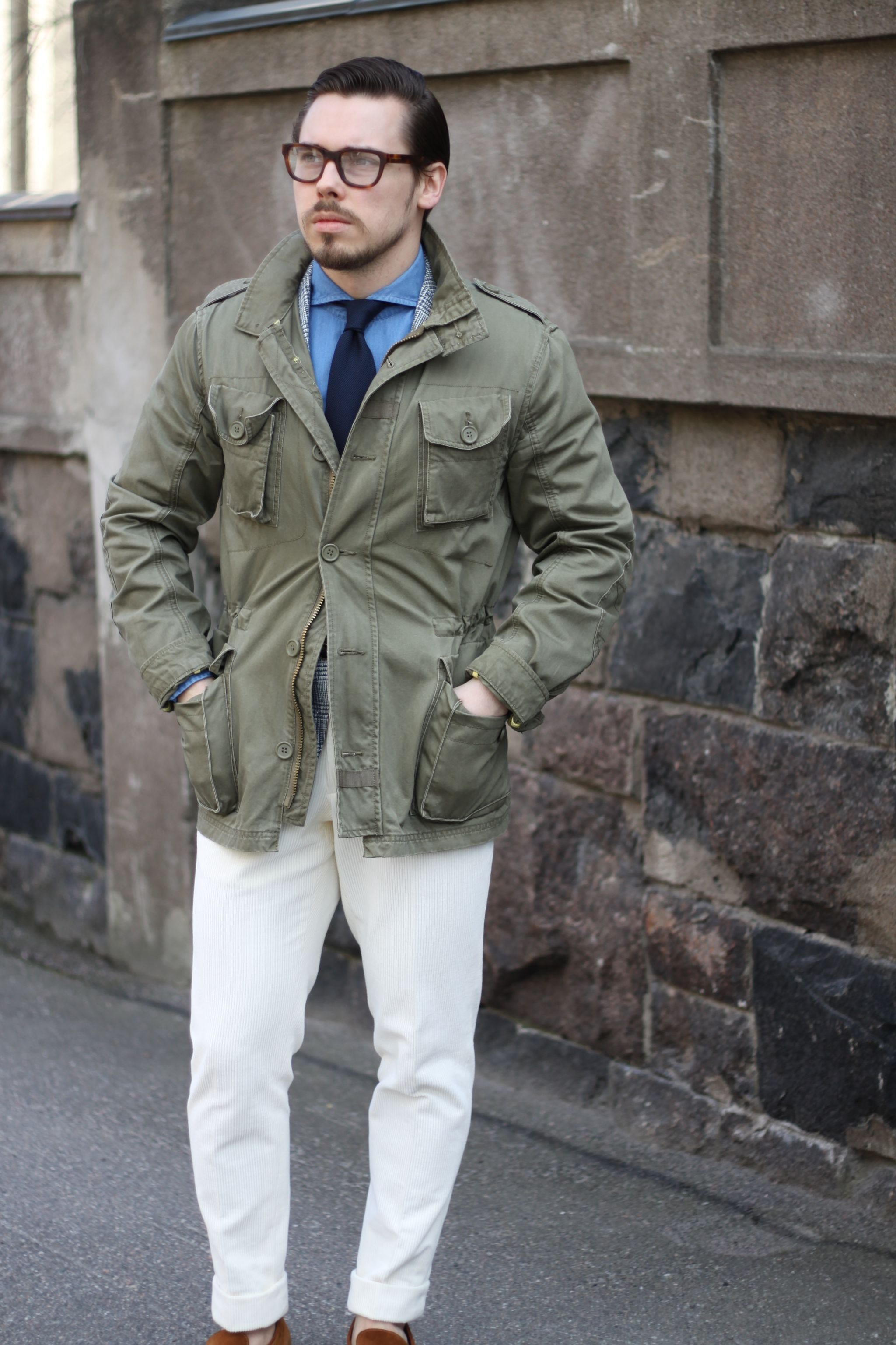 m65 field jacket with denim shirt and white trousers