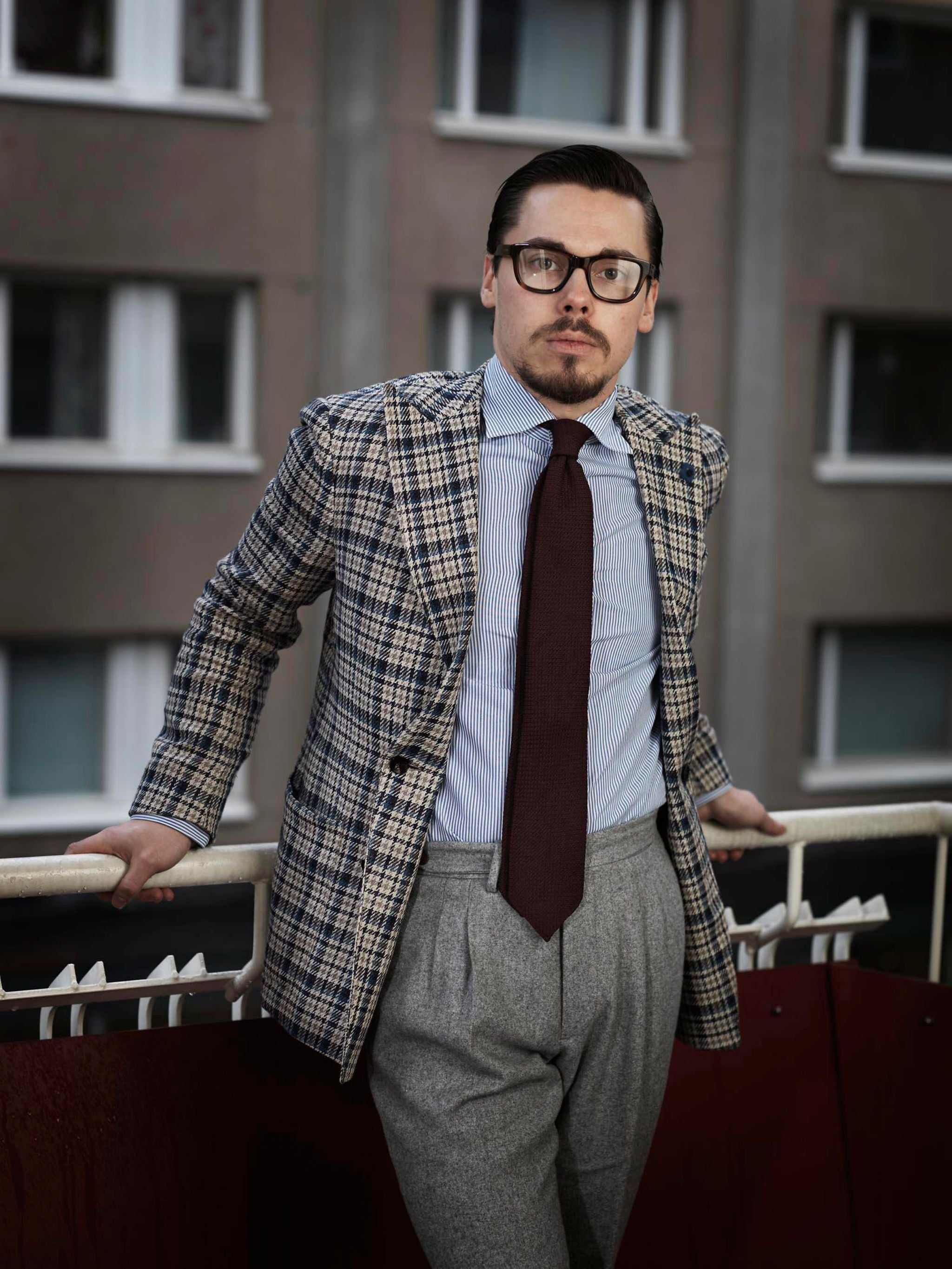 sport coat with gray flannel trousers