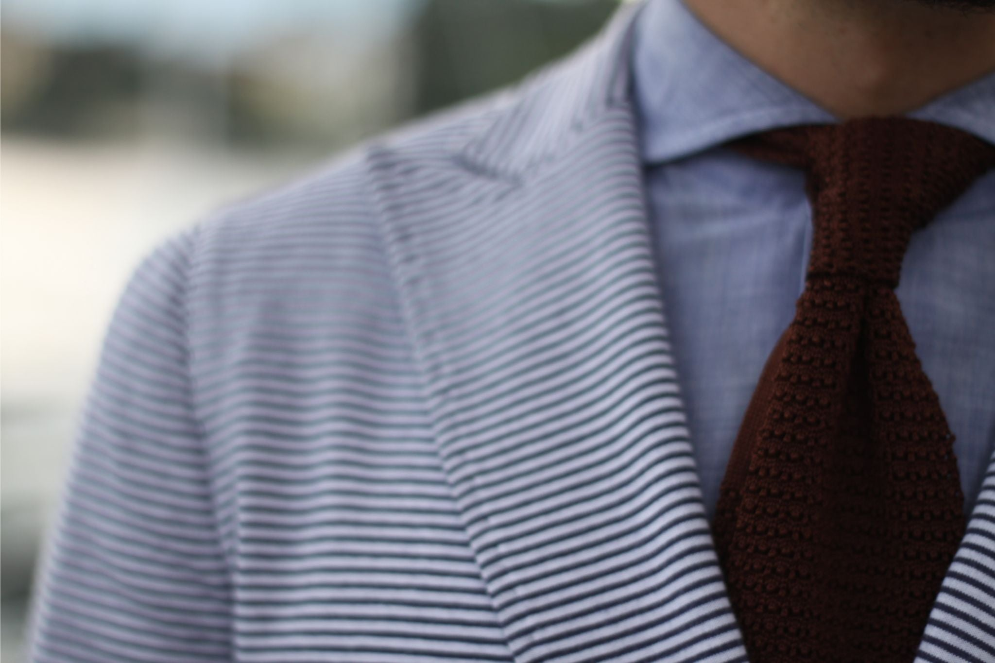wearing brown knitted tie